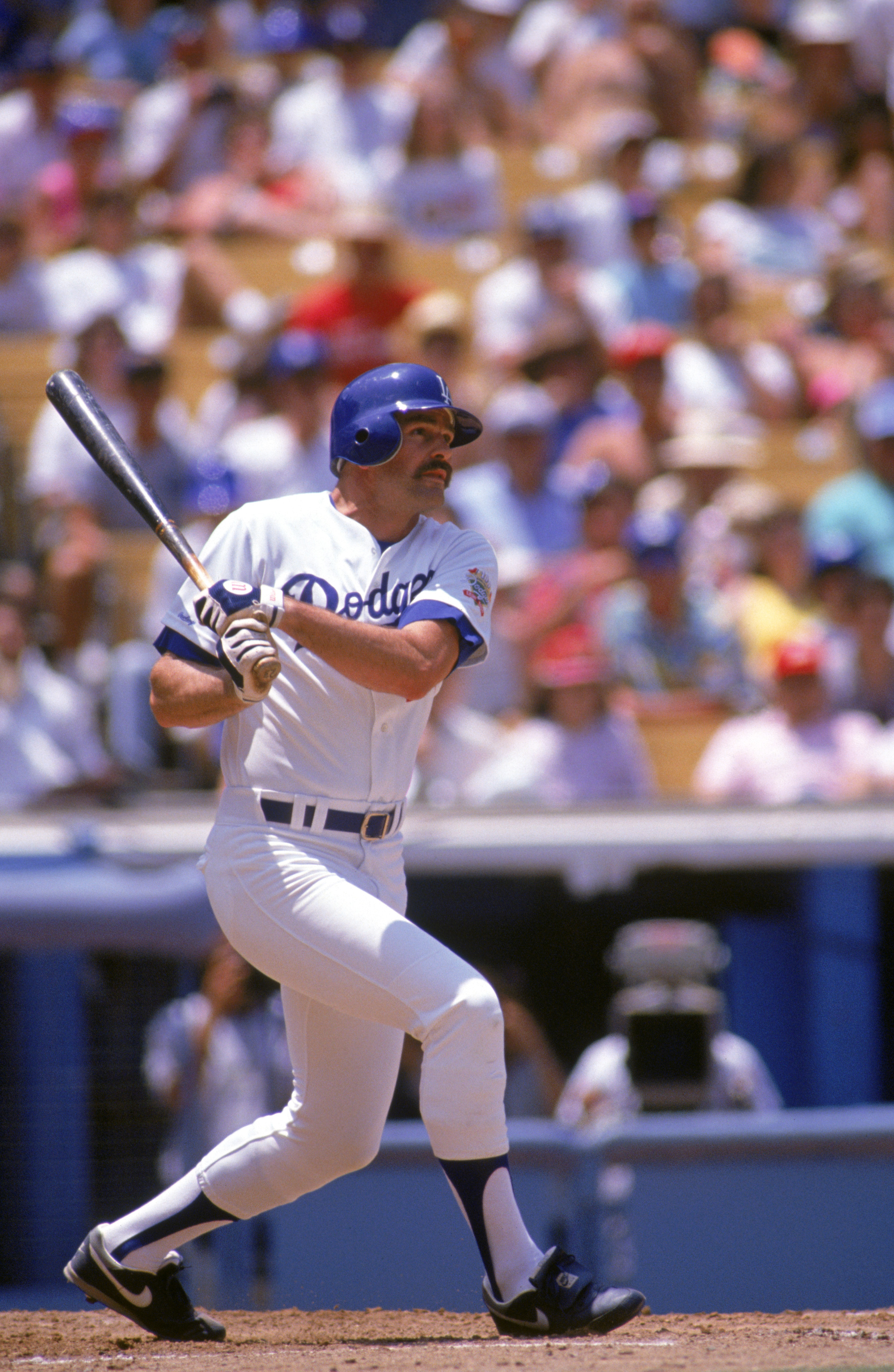 LOS ANGELES - 1990:  Kirk Gibson #23 of the Los Angeles Dodgers swings at a pitch during a 1990 game at Dodger Stadium in Los Angeles, California. (Photo by Ken Levine/Getty Images)