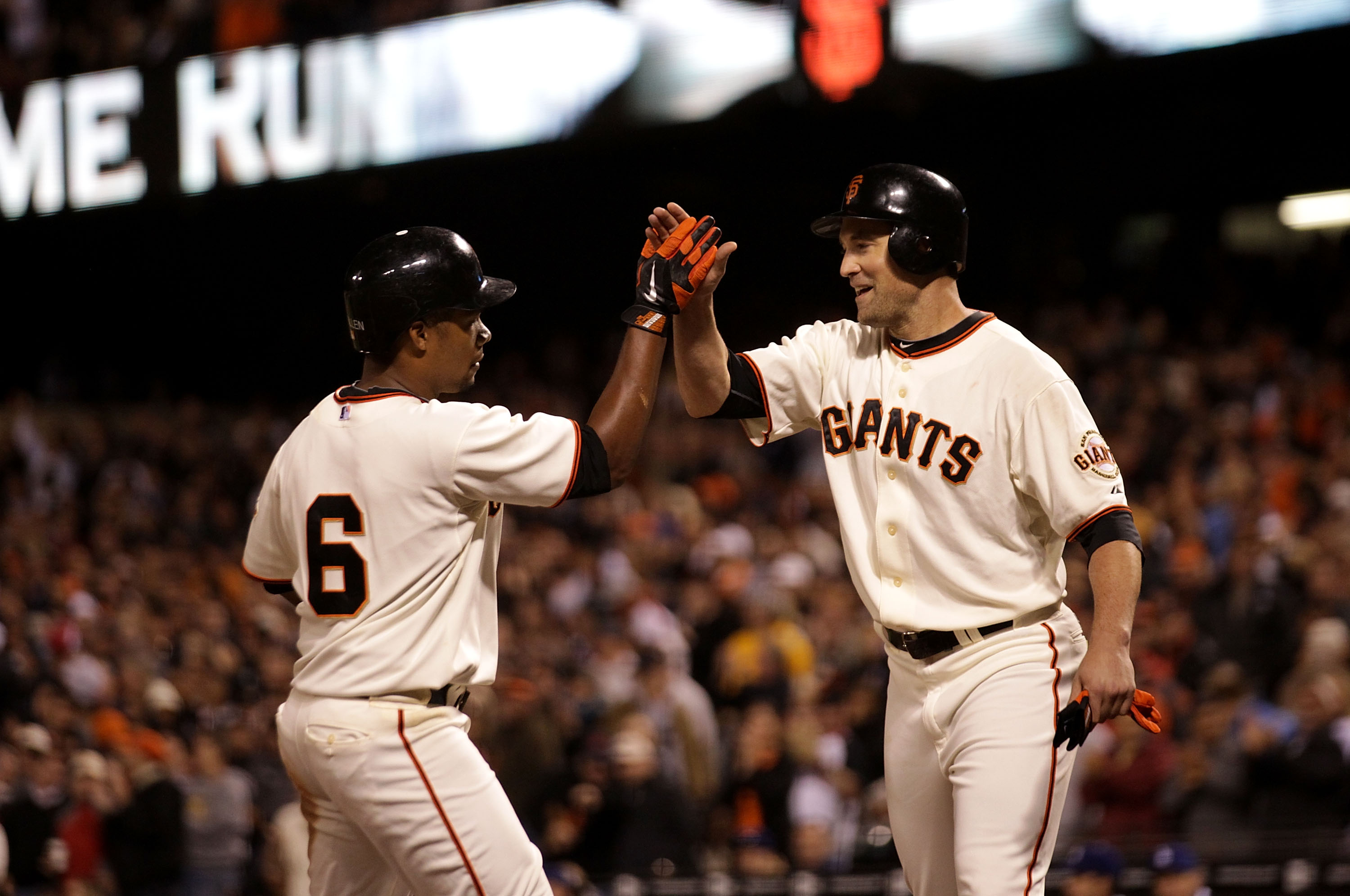 SAN FRANCISCO - SEPTEMBER 16: Jose Gullien #6 of the San Francisco Giants celebrates with Pat Burrell #9 after hitting a two run home in the fifth inning gainst the Los Angeles Dodgers during a Major League Baseball game at AT&T Park on September 16, 2010
