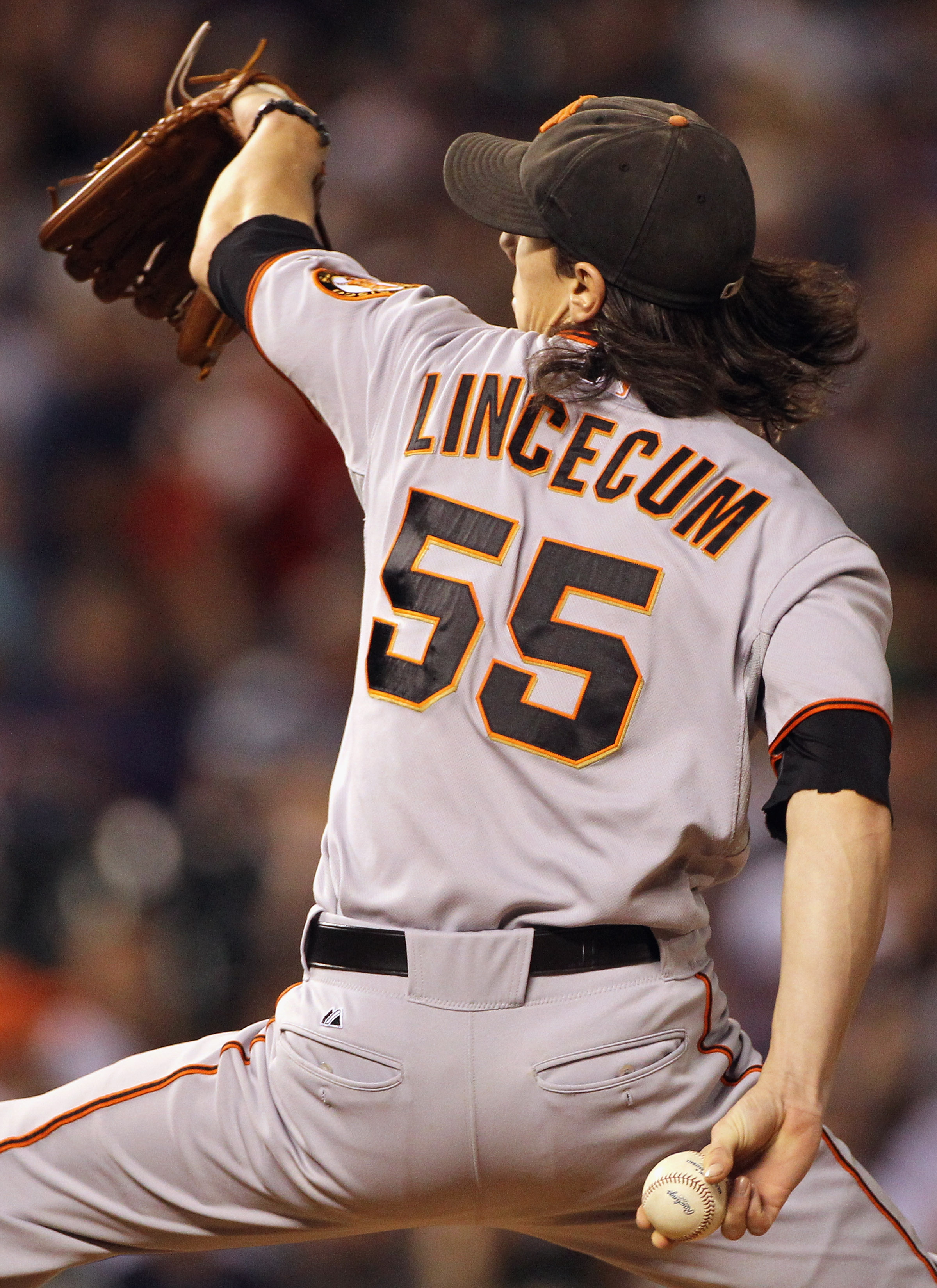 DENVER - SEPTEMBER 24:  Starting pitcher Tim Lincecum #55 of the San Francisco Giants delivers against the Colorado Rockies at Coors Field on September 24, 2010 in Denver, Colorado. Lincecum earned the win as the Giants defeated the Rockies 2-1.  (Photo b