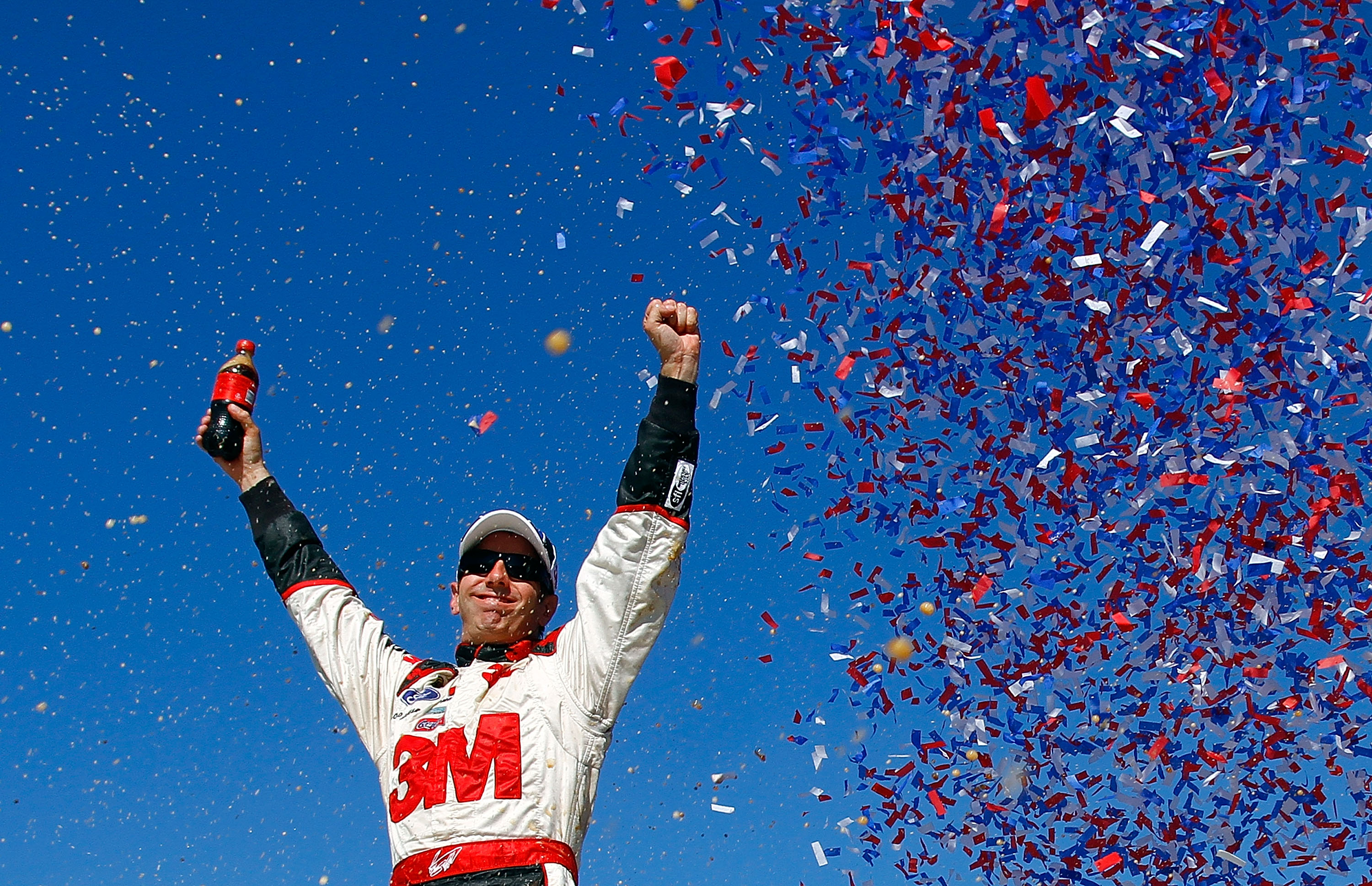 KANSAS CITY, KS - OCTOBER 03:  Greg Biffle, driver of the #16 3M Ford, celebrates in victory lane after winning the NASCAR Sprint Cup Series Price Chopper 400 on October 3, 2010 in Kansas City, Kansas.  (Photo by Jason Smith/Getty Images for NASCAR)