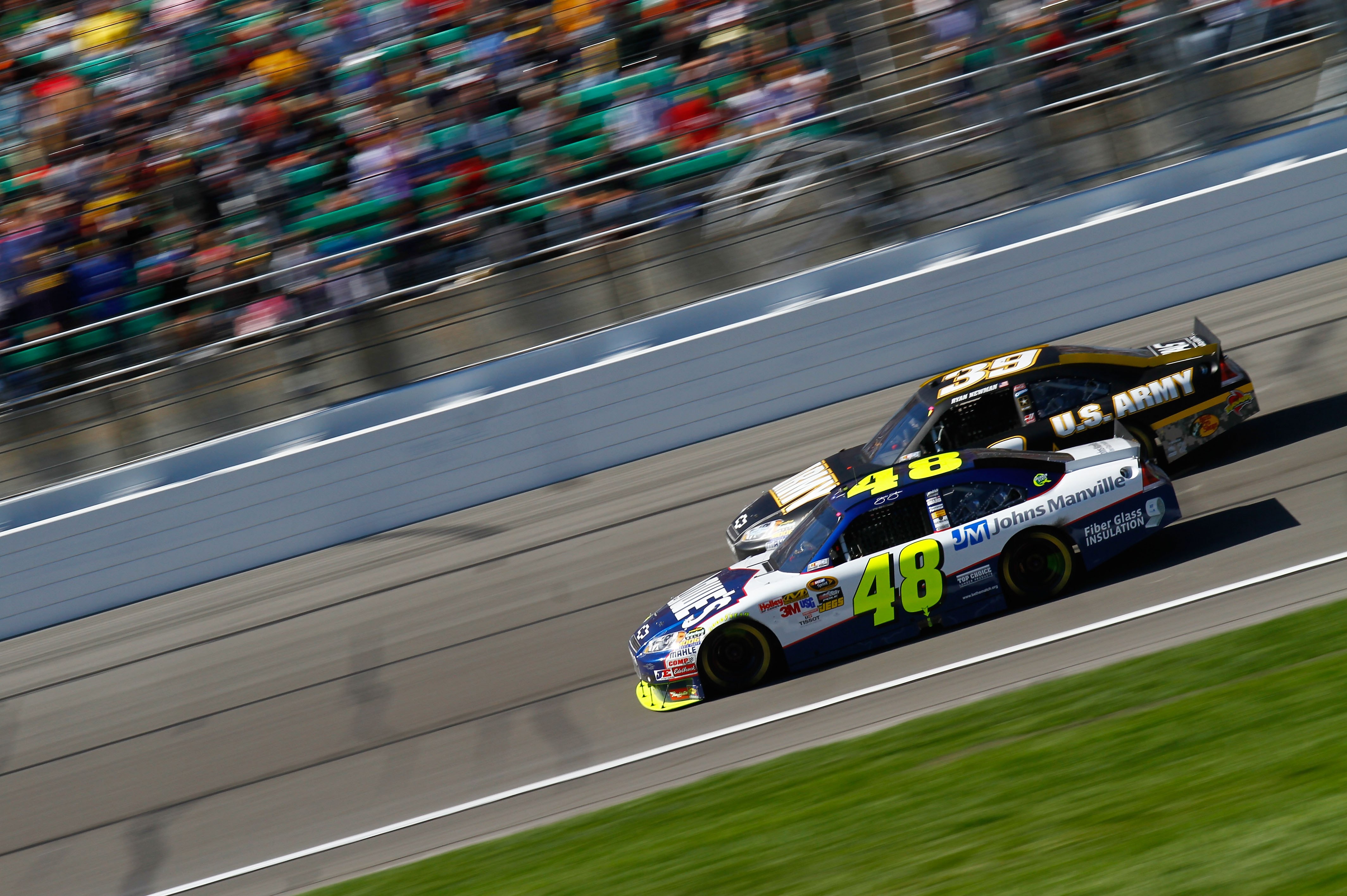 KANSAS CITY, KS - OCTOBER 03:  Jimmie Johnson, driver of the #48 Lowe's Chevrolet, races Ryan Newman, driver of the #39 U.S. Army Chevrolet, during the NASCAR Sprint Cup Series Price Chopper 400 on October 3, 2010 in Kansas City, Kansas.  (Photo by Jason