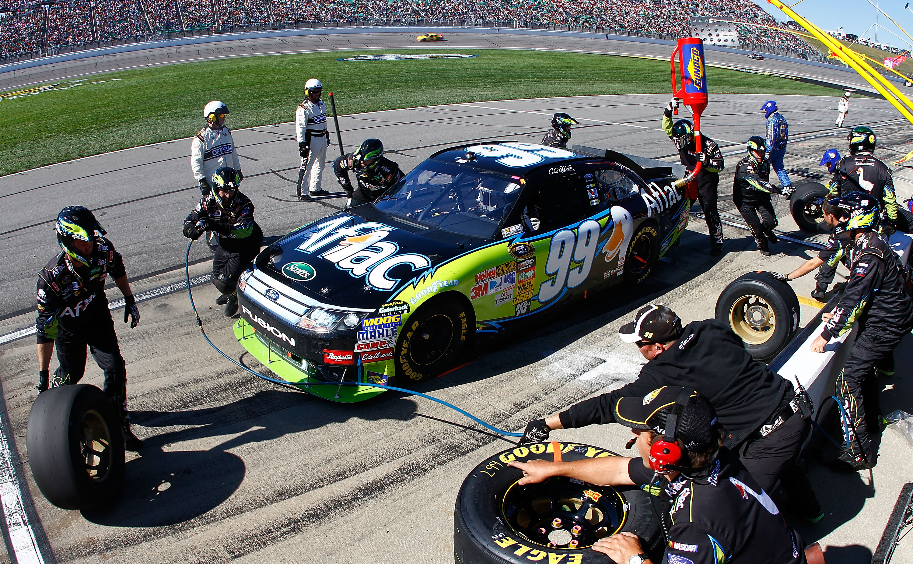 KANSAS CITY, KS - OCTOBER 03:  Carl Edwards, driver of the #99 Aflac Ford, makes a pit stop during the NASCAR Sprint Cup Series Price Chopper 400 on October 3, 2010 in Kansas City, Kansas.  (Photo by Jason Smith/Getty Images for NASCAR)