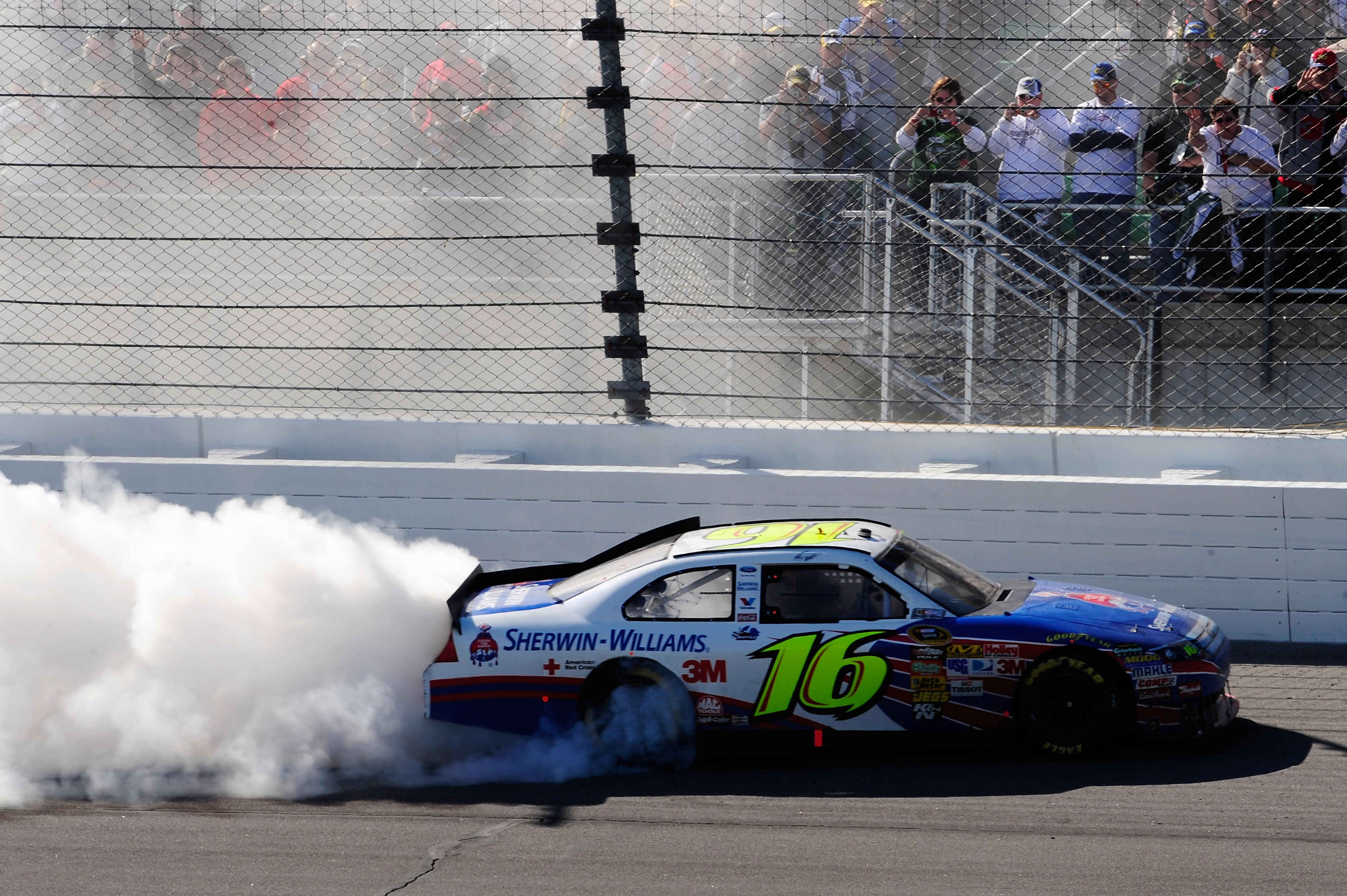 KANSAS CITY, KS - OCTOBER 03:  Greg Biffle, driver of the #16 3M Ford, celebrates with a burnout after winning the NASCAR Sprint Cup Series Price Chopper 400 on October 3, 2010 in Kansas City, Kansas.  (Photo by Rusty Jarrett/Getty Images)