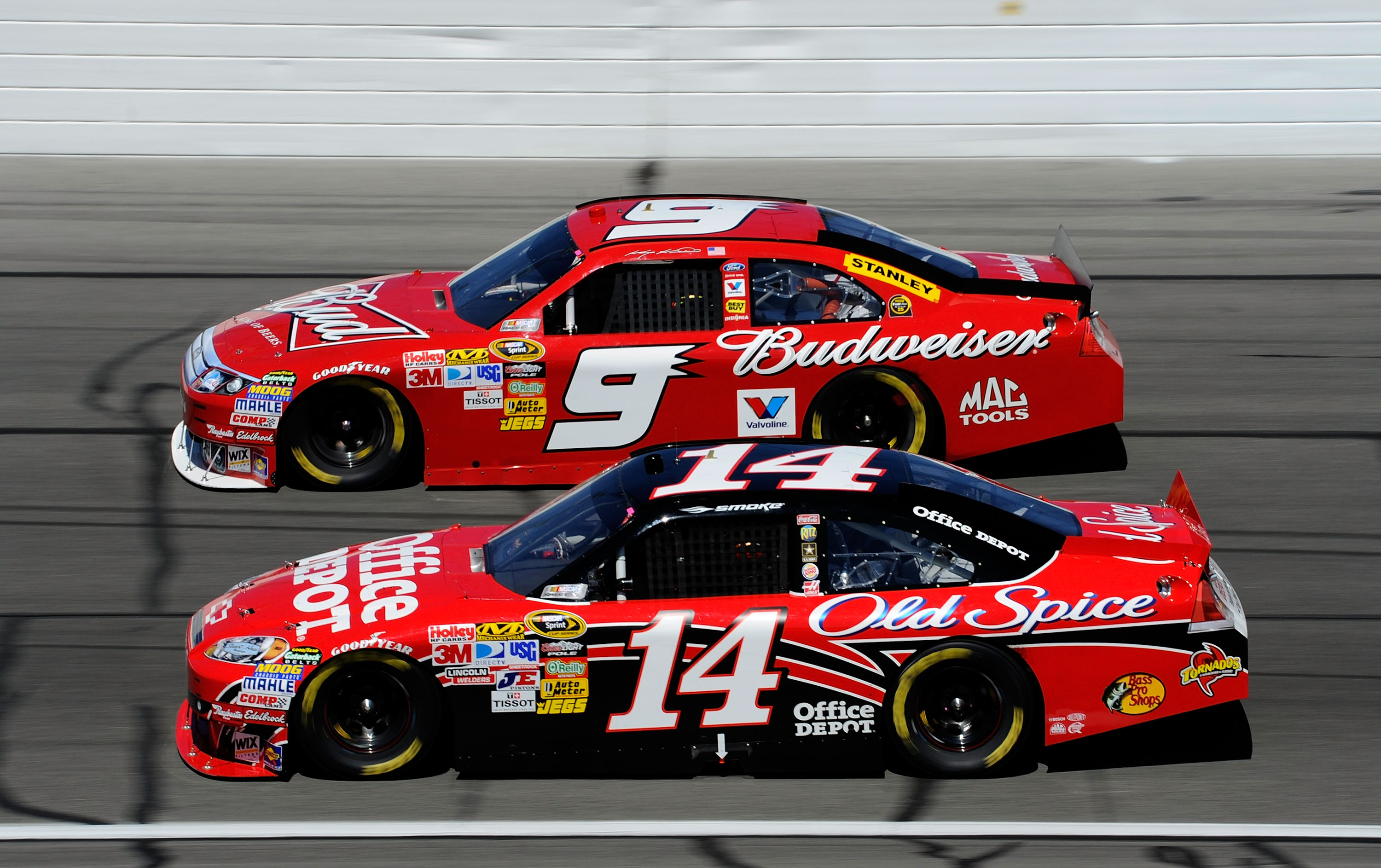 KANSAS CITY, KS - OCTOBER 03:  Tony Stewart, driver of the #14 Office Depot Chevrolet, races Kasey Kahne, driver of the #9 Budweiser Ford, during the NASCAR Sprint Cup Series Price Chopper 400 on October 3, 2010 in Kansas City, Kansas.  (Photo by John Har