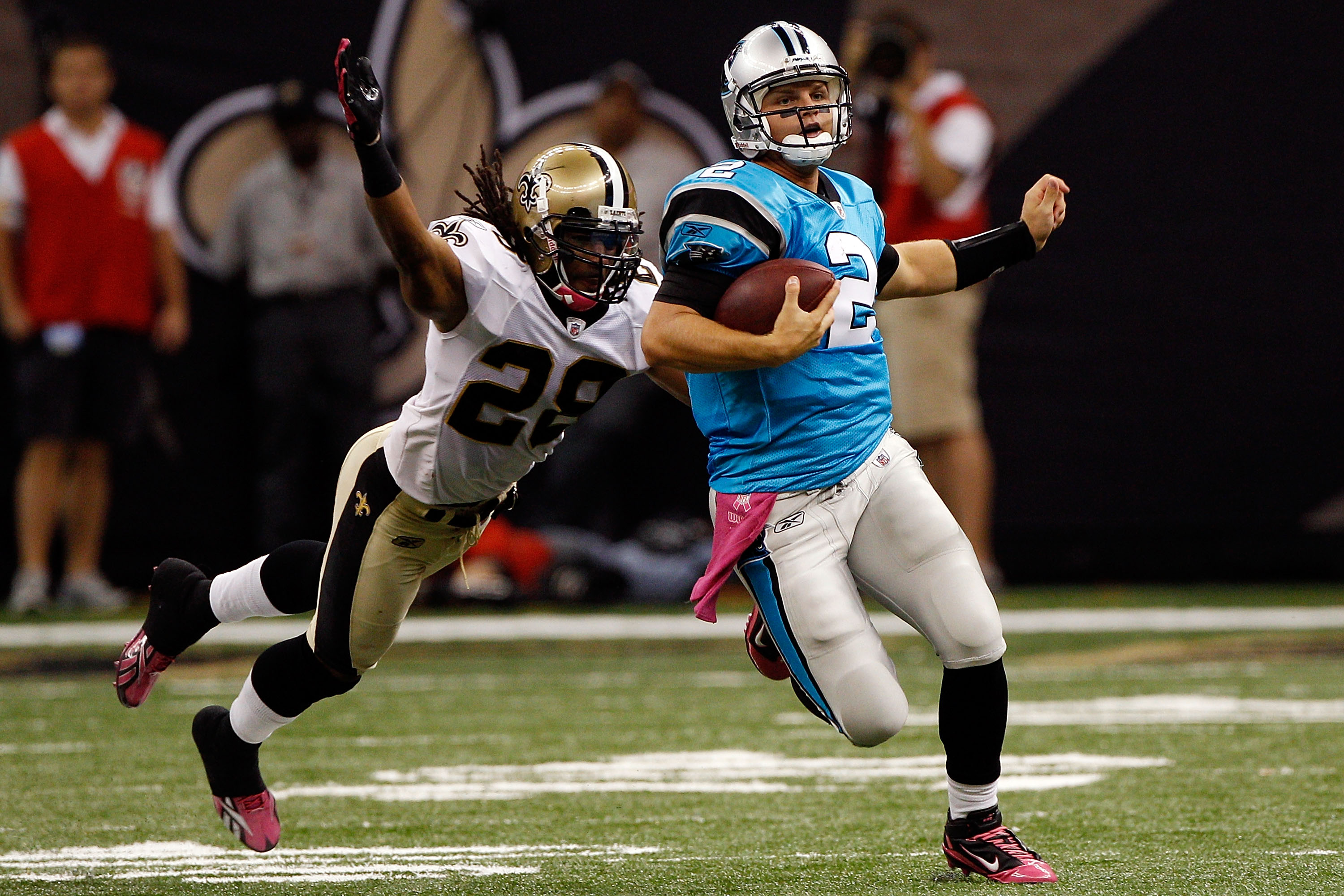 NEW ORLEANS - OCTOBER 03:  Jimmy Clausen #2 of the Carolina Panthers is tackled by Usama Young #28 of the New Orleans Saints at the Louisiana Superdome on October 3, 2010 in New Orleans, Louisiana.  (Photo by Chris Graythen/Getty Images)