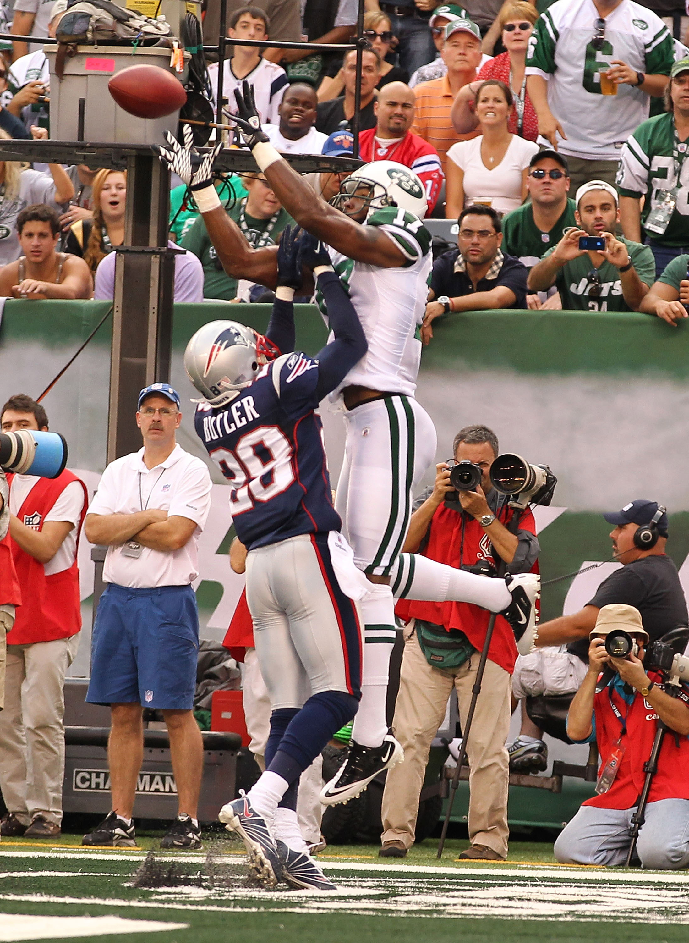 EAST RUTHERFORD, NJ - SEPTEMBER 19:  Braylon Edwards #17 of the New York Jets catches a touchdown against Darius Butler #28 of the New England Patriots during their  game on September 19, 2010 at the New Meadowlands Stadium  in East Rutherford, New Jersey