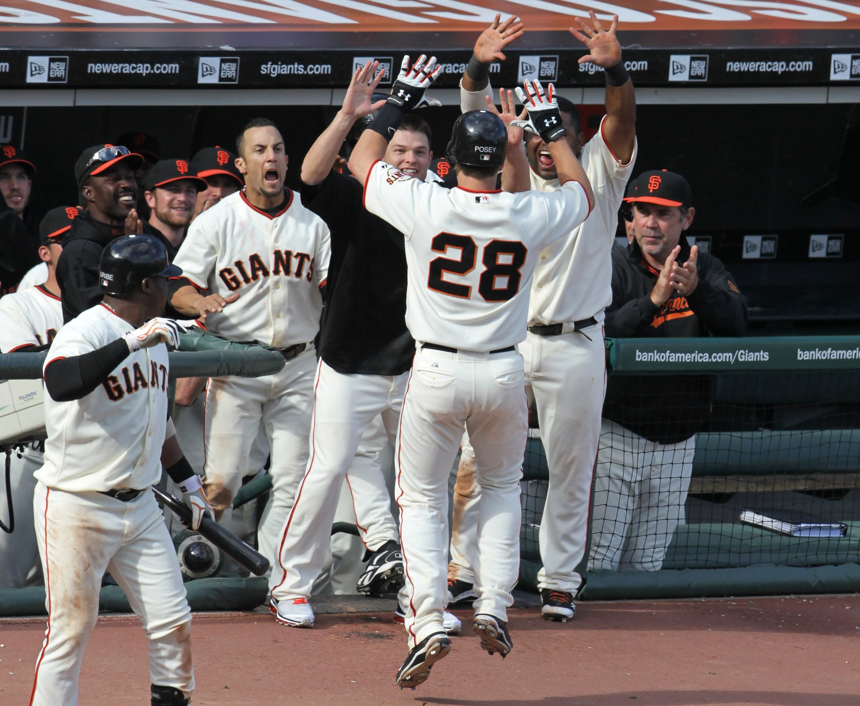 SAN FRANCISCO - OCTOBER 03:  Buster Posey #28 of the San Francisco Giants is congratulated by teammates after hitting a solo home run during the eighth inning against the San Diego Padres at AT&T Park on October 3, 2010 in San Francisco, California.  The