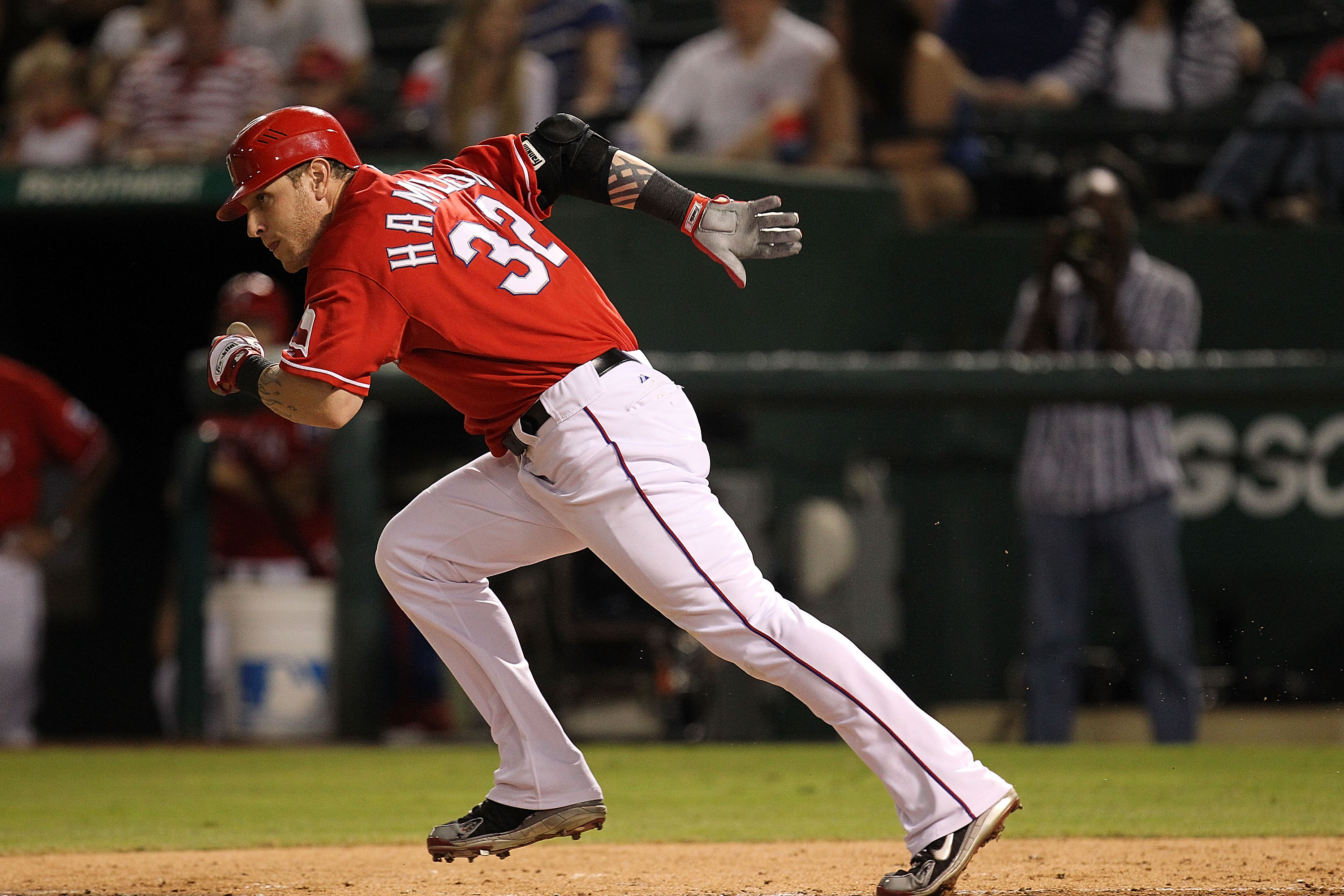 ARLINGTON, TX - OCTOBER 01:  Josh Hamilton #32 of the Texas Rangers runs on a ground out against Los Angeles Angels of Anaheim at Rangers Ballpark in Arlington on October 1, 2010 in Arlington, Texas.  (Photo by Ronald Martinez/Getty Images)
