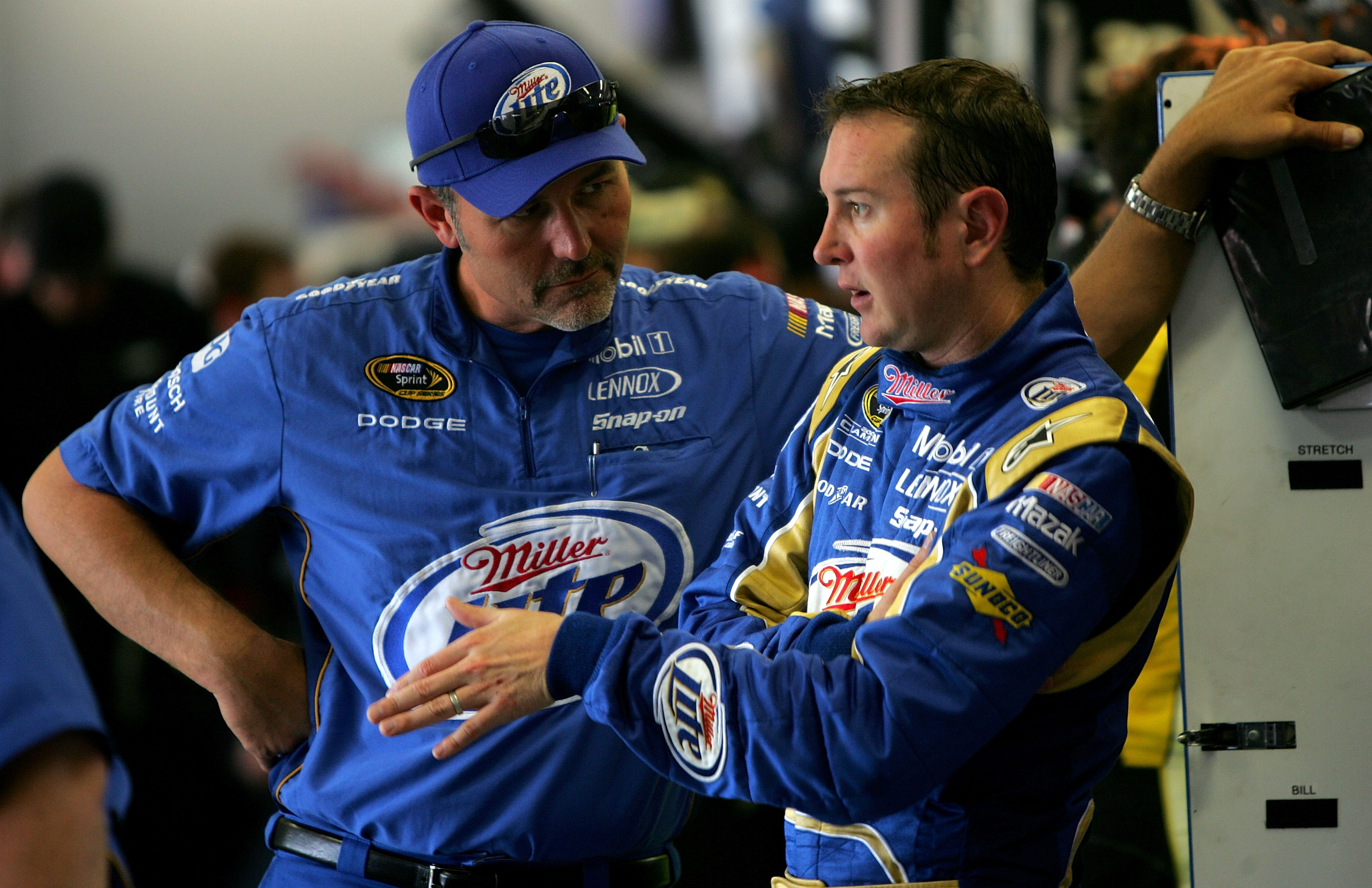 FORT WORTH, TX - APRIL 16:  Kurt Busch (R), driver of the #2 Miller Lite Dodge, talks with crew chief Steve Addington in the garage during practice for the NASCAR Sprint Cup Series Samsung Mobile 500 at Texas Motor Speedway on April 16, 2010 in Fort Worth