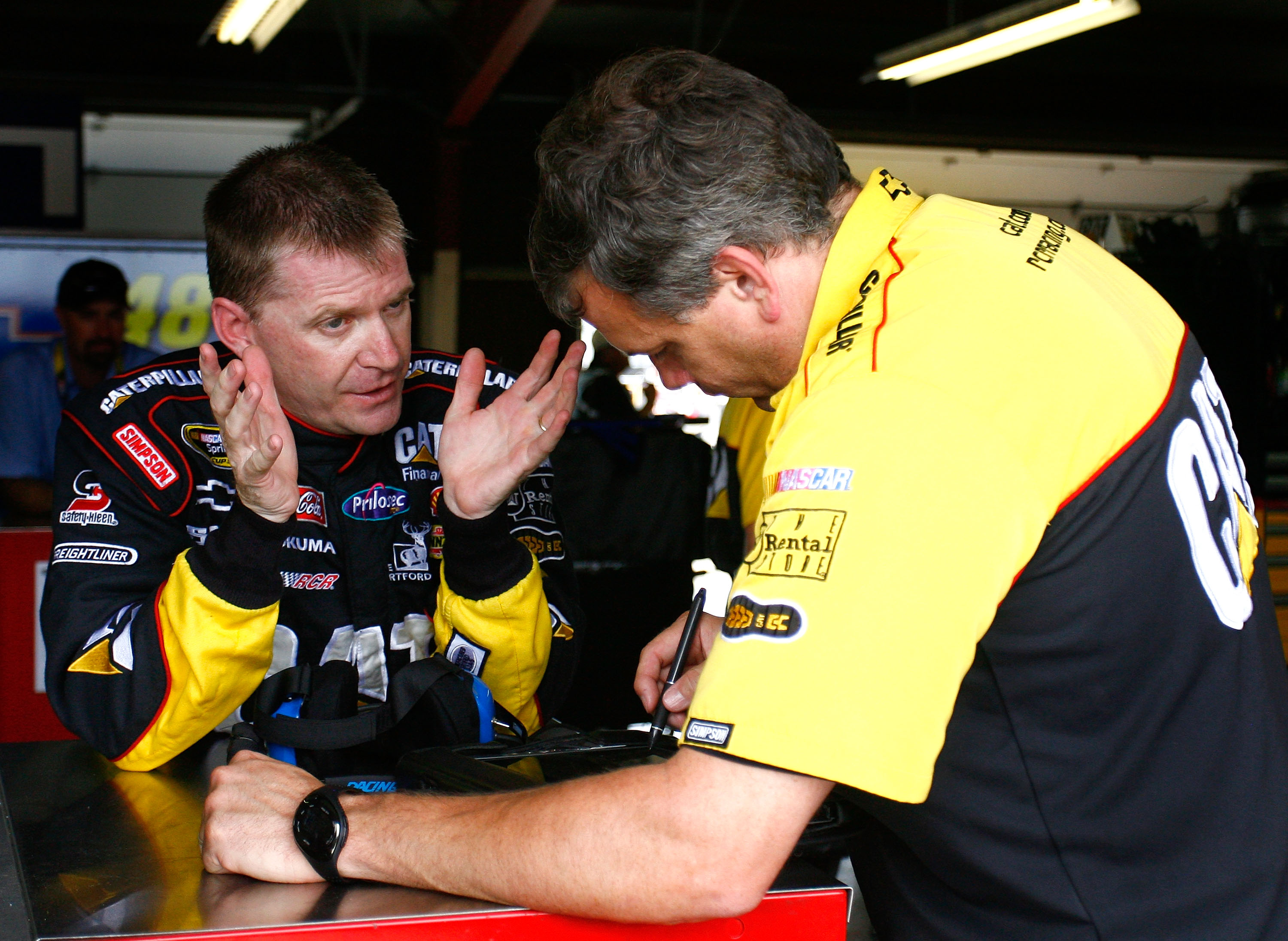 BROOKLYN, MI - JUNE 12:  Jeff Burton (L), driver of the #31 Caterpillar Chevrolet speaks with crew chief Todd Berrier (R) during practice for the NASCAR Sprint Cup Series Heluva Good! Sour Cream Dips 400 at Michigan International Speedway on June 12, 2010