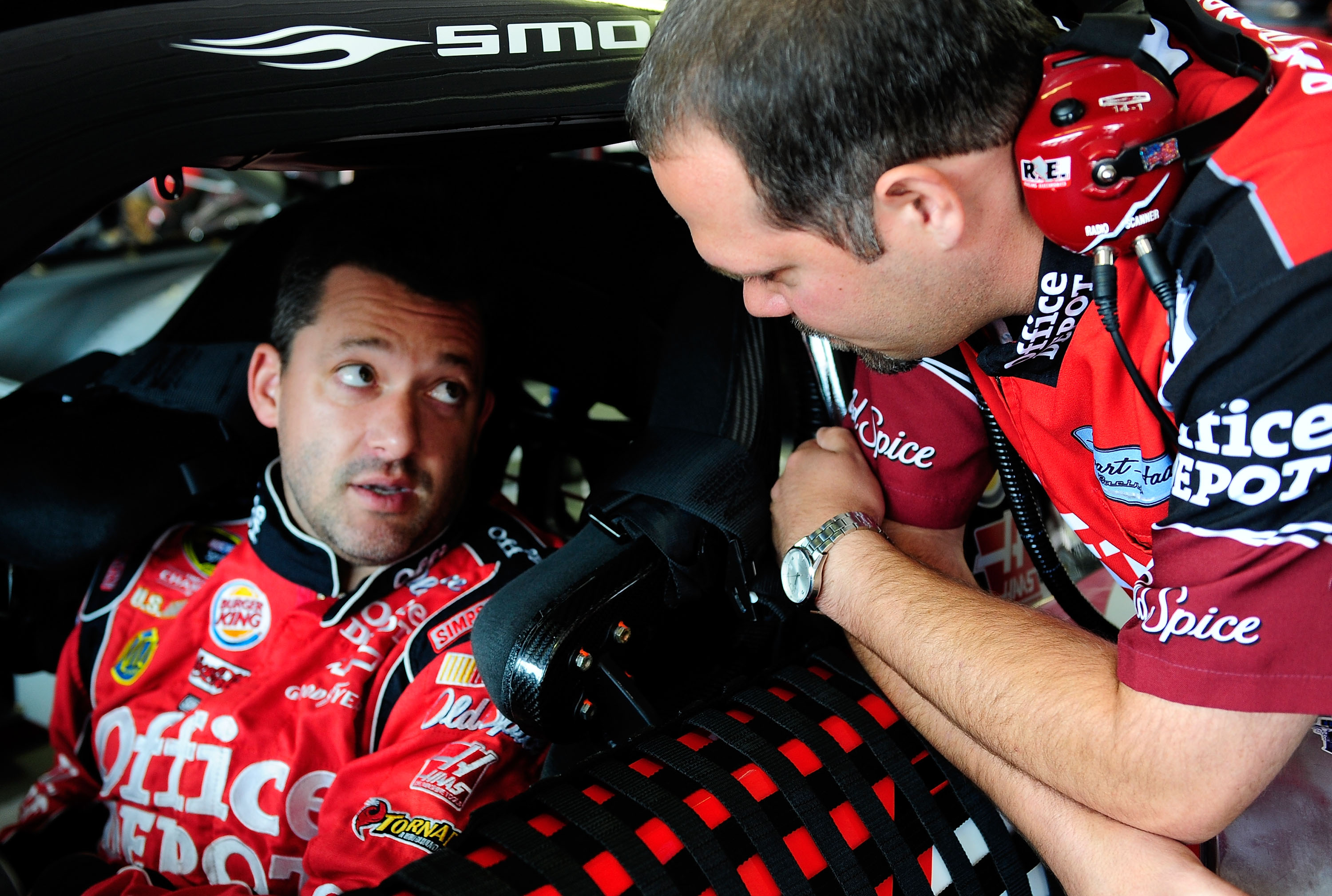 LONG POND, PA - JULY 30:  Tony Stewart (L), driver of the #14 Office Depot/Old Spice Chevrolet, talks with crew chief Darian Grubb in the garage during practice for the NASCAR Sprint Cup Series Sunoco Red Cross Pennsylvania 500 at Pocono Raceway on July 3