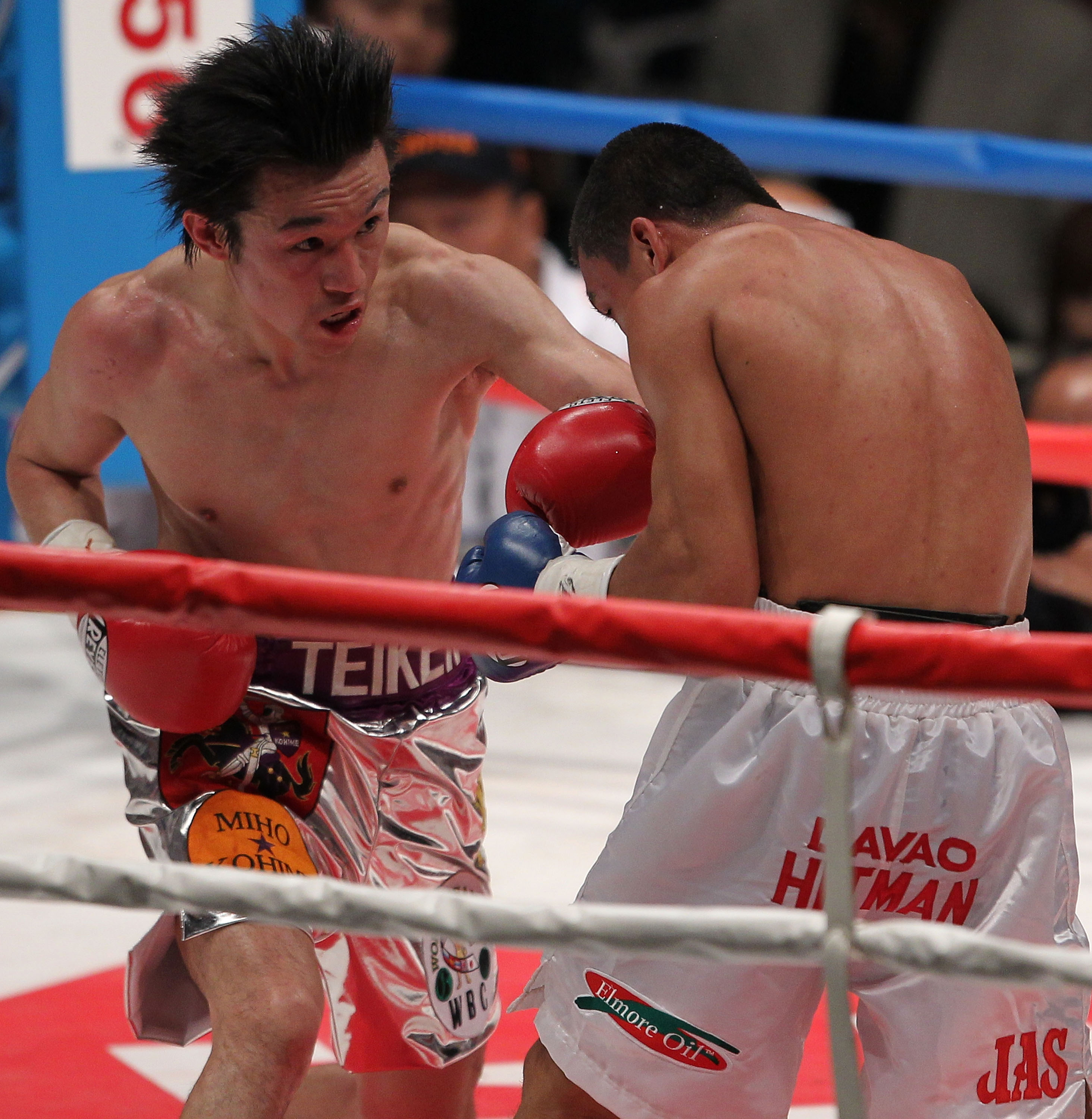 TOKYO - APRIL 30:  Champion Toshiaki Nishioka of Japan (L) exchange punches with challenger Balweg Bangoyan of the Philippines in action during the WBC Super-Bantamweight title fight at Nippon Budokan on April 30, 2010 in Tokyo, Japan.  (Photo by Koichi K