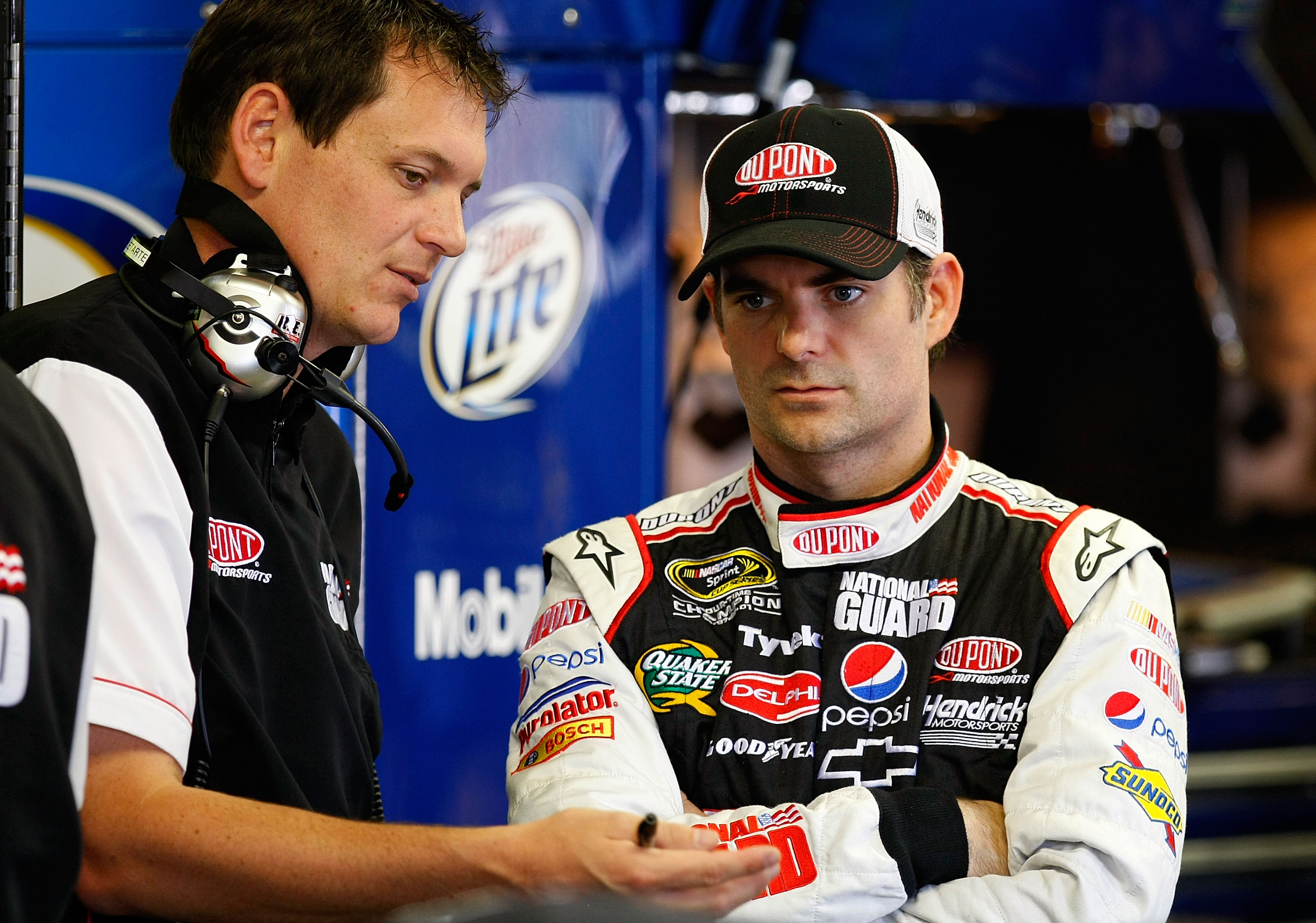 BROOKLYN, MI - JUNE 12: Jeff Gordon (R), driver of the #24 DuPont/National Guard Job Skills Chevrolet, talks with crew chief Steve Letarte (L) in the garage during practice for the NASCAR Sprint Cup Series Heluva Good! Sour Cream Dips 400 at Michigan Inte