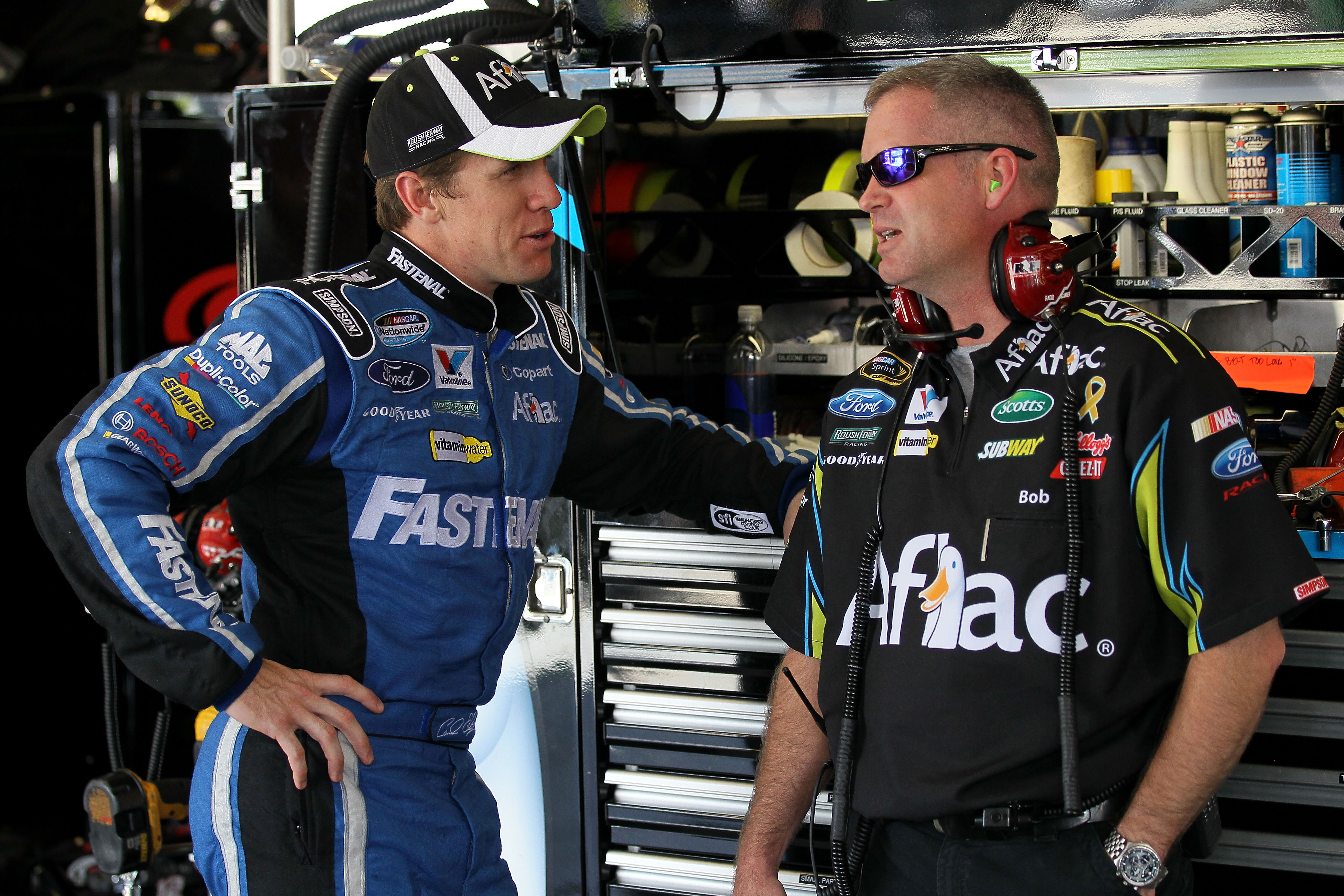 JOLIET, IL - JULY 09:  Carl Edwards (L), driver of the #99 Aflac Silver Ford, talks with crew chief Bob Osborne during practice for the NASCAR Sprint Cup Series LIFELOCK.COM 400 at the Chicagoland Speedway on July 9, 2010 in Joliet, Illinois.  (Photo by A