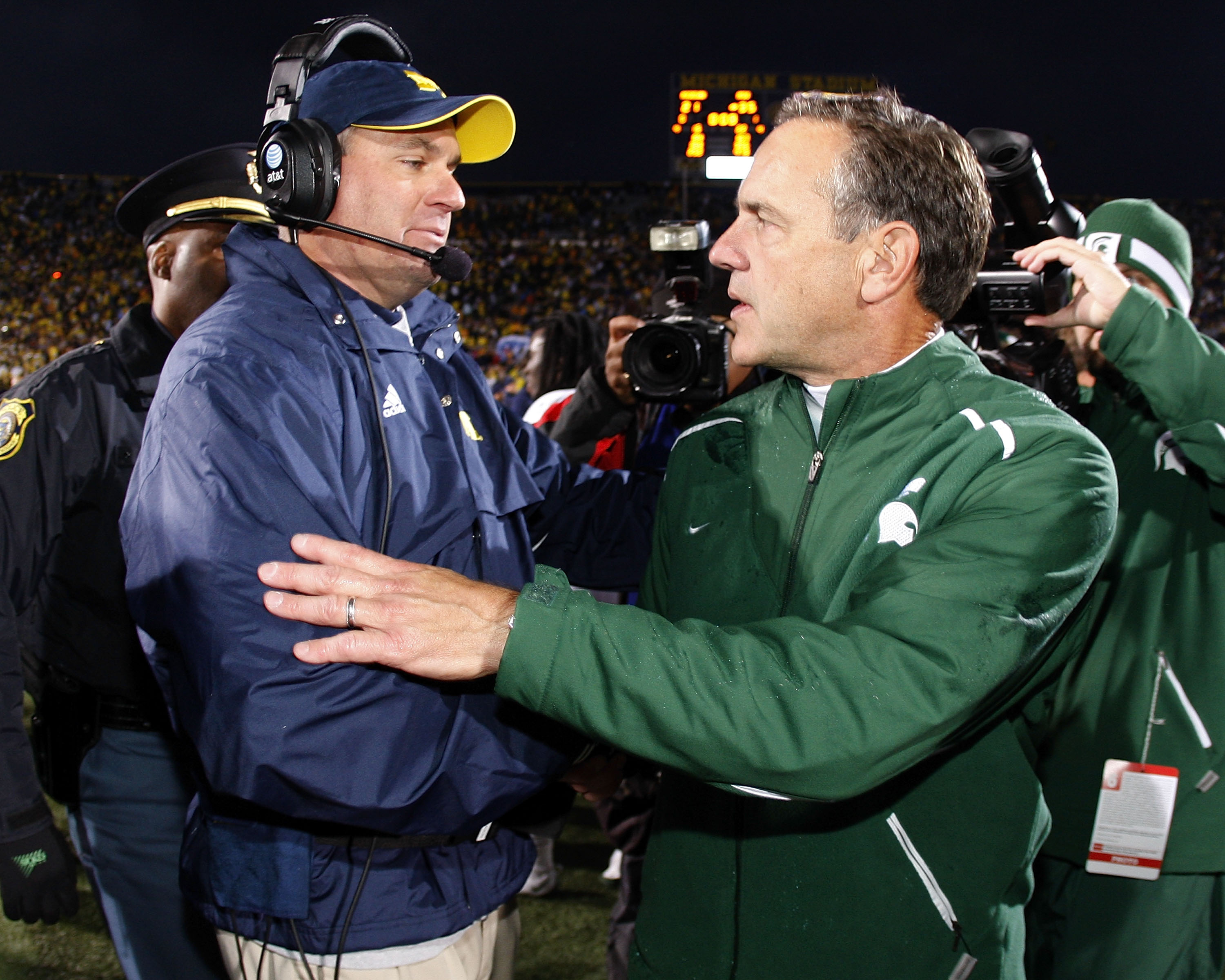 ANN ARBOR, MI - OCTOBER 25: Head coach Mark Dantonio of the Michigan State Spartans shakes hands with head coach Rich Rodriguez of the Michigan Wolverines after a Michigan State 35-21 victory on October 25, 2008 at Michigan Stadium in Ann Arbor, Michigan.