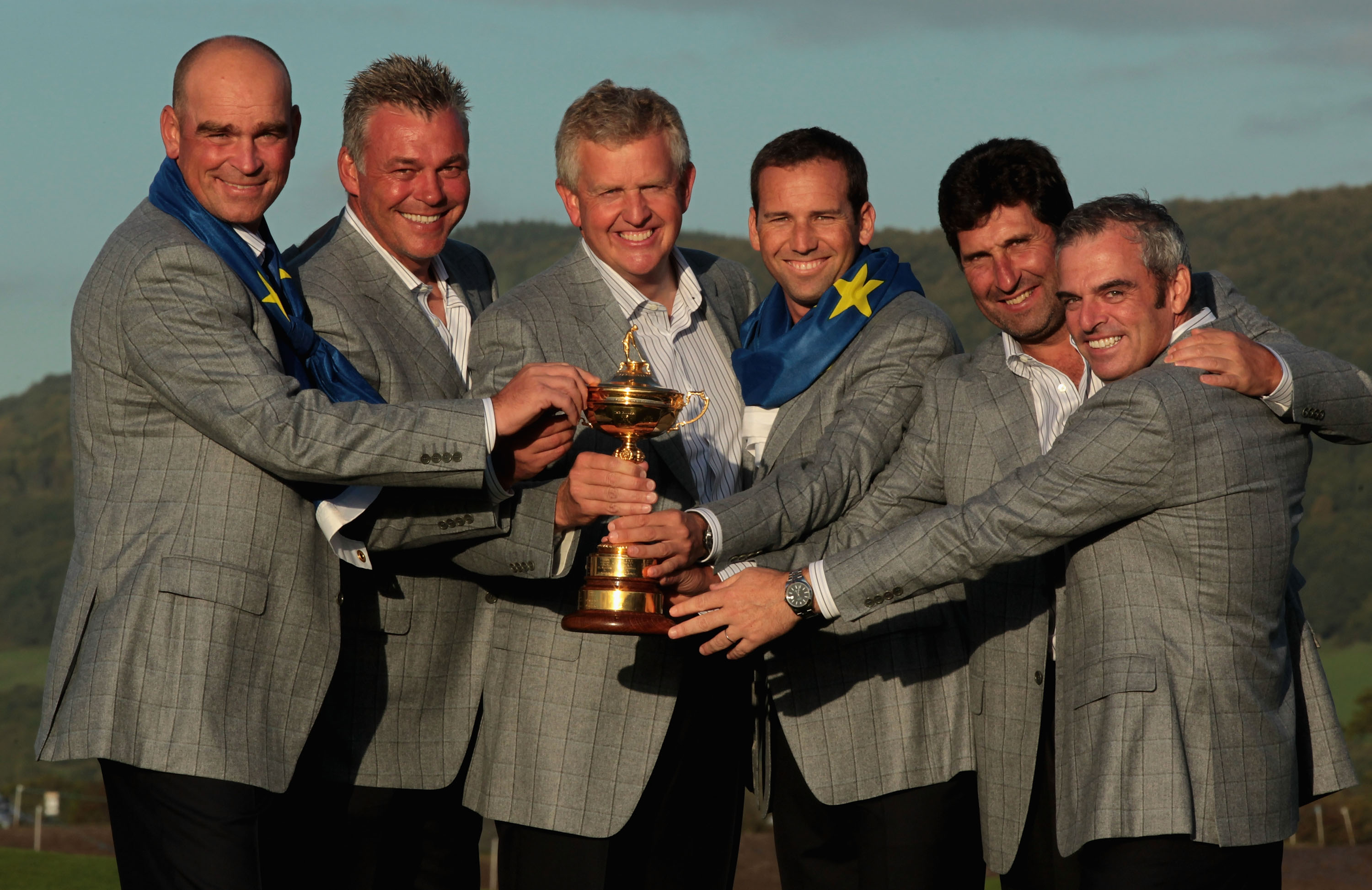 NEWPORT, WALES - OCTOBER 04:  European Team Captain Colin Montgomerie (C) poses with the Ryder Cup and his vice captains (L-R) Thomas Bjorn, Darren Clarke, Sergio Garcia, Jose Maria Olazabal and Paul McGinley following Europe's 14.5 to 13.5 victory over t