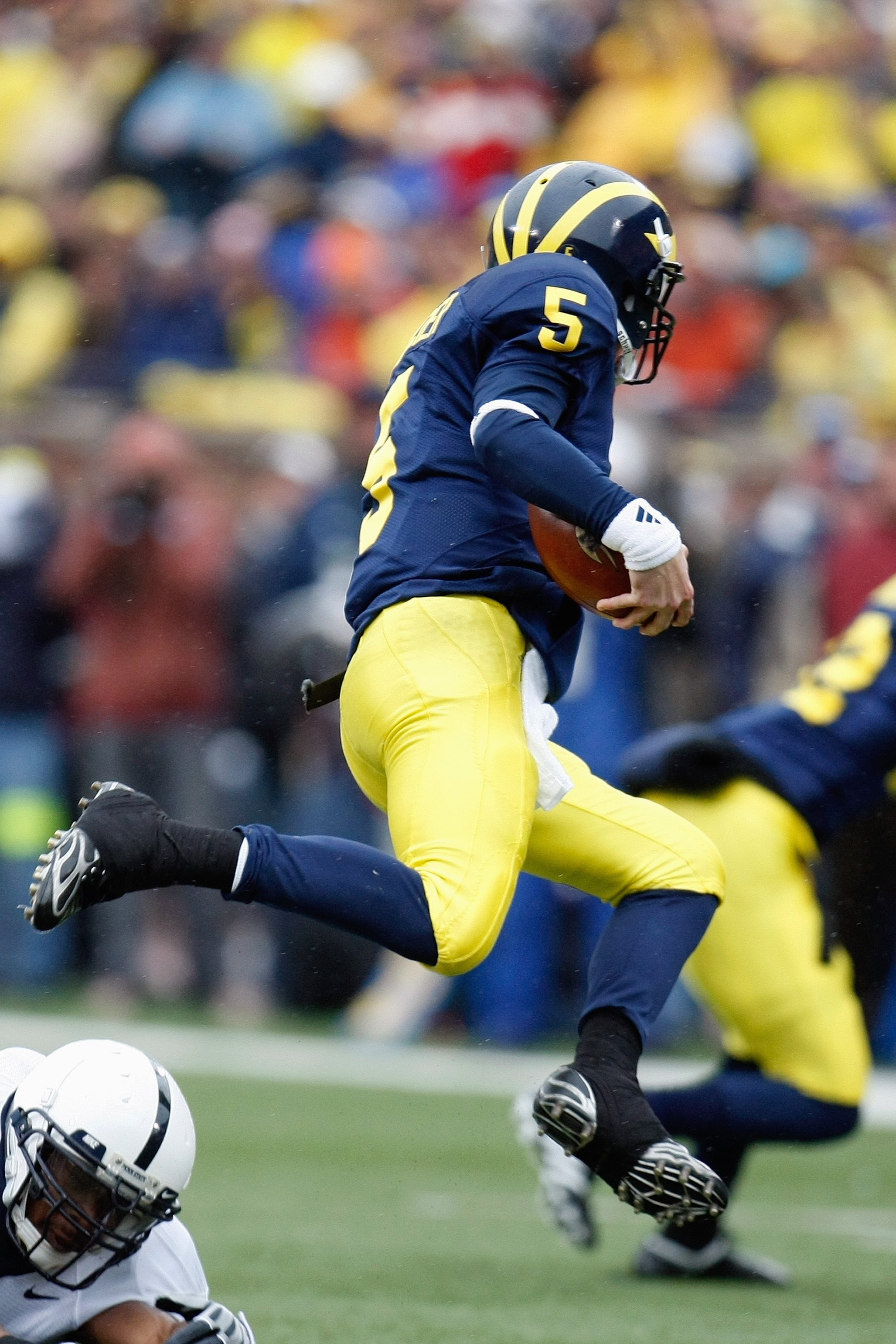 ANN ARBOR, MI - OCTOBER 24:  Tate Forcier #5 of the Michigan Wolverines carries the ball during the game against the Penn State Nittany Lions on October 24, 2009 at Michigan Stadium in Ann Arbor, Michigan. (Photo by  Gregory Shamus/Getty Images)
