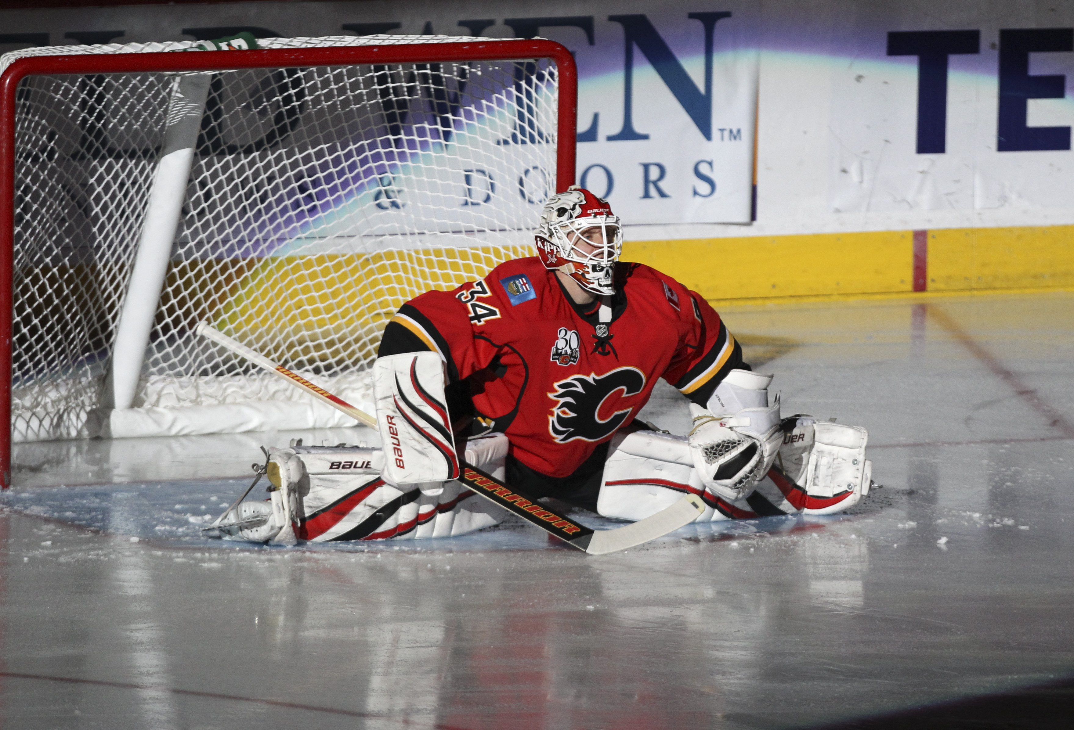 CALGARY, AB -APRIL 6: Miikka Kiprusoff #34 of the Calgary Flames stretches as he is introduced before playing the San Jose Sharks in the NHL game on April 6, 2010 at the Pengrowth Saddledome in Calgary, Alberta. (Photo by Mike Ridewood/Getty Images)