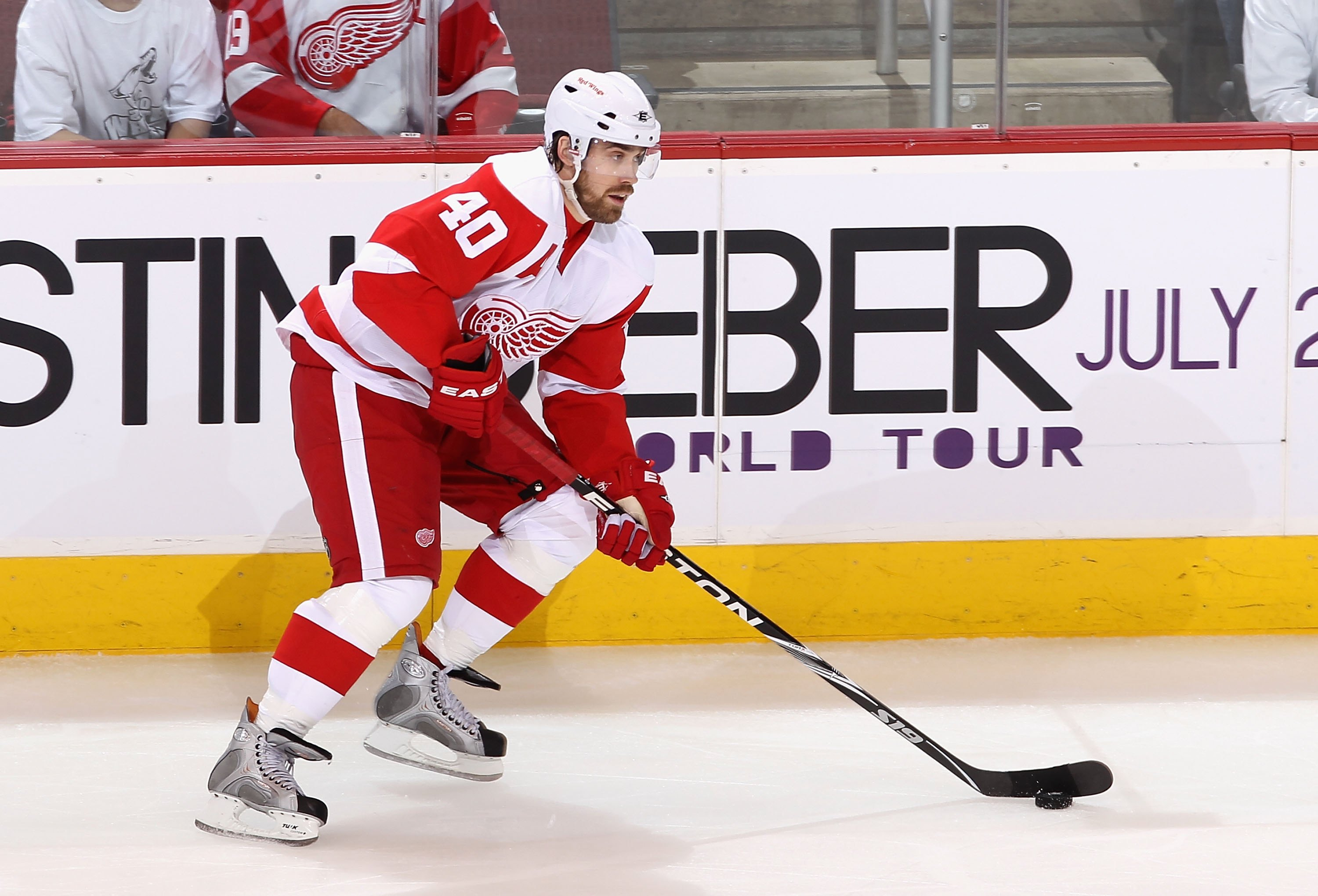 GLENDALE, AZ - APRIL 14:  Henrik Zetterberg #40 of the Detroit Red Wings skates with the puck in Game One of the Western Conference Quarterfinals against the Phoenix Coyotes during the 2010 NHL Stanley Cup Playoffs at Jobing.com Arena on April 14, 2010 in