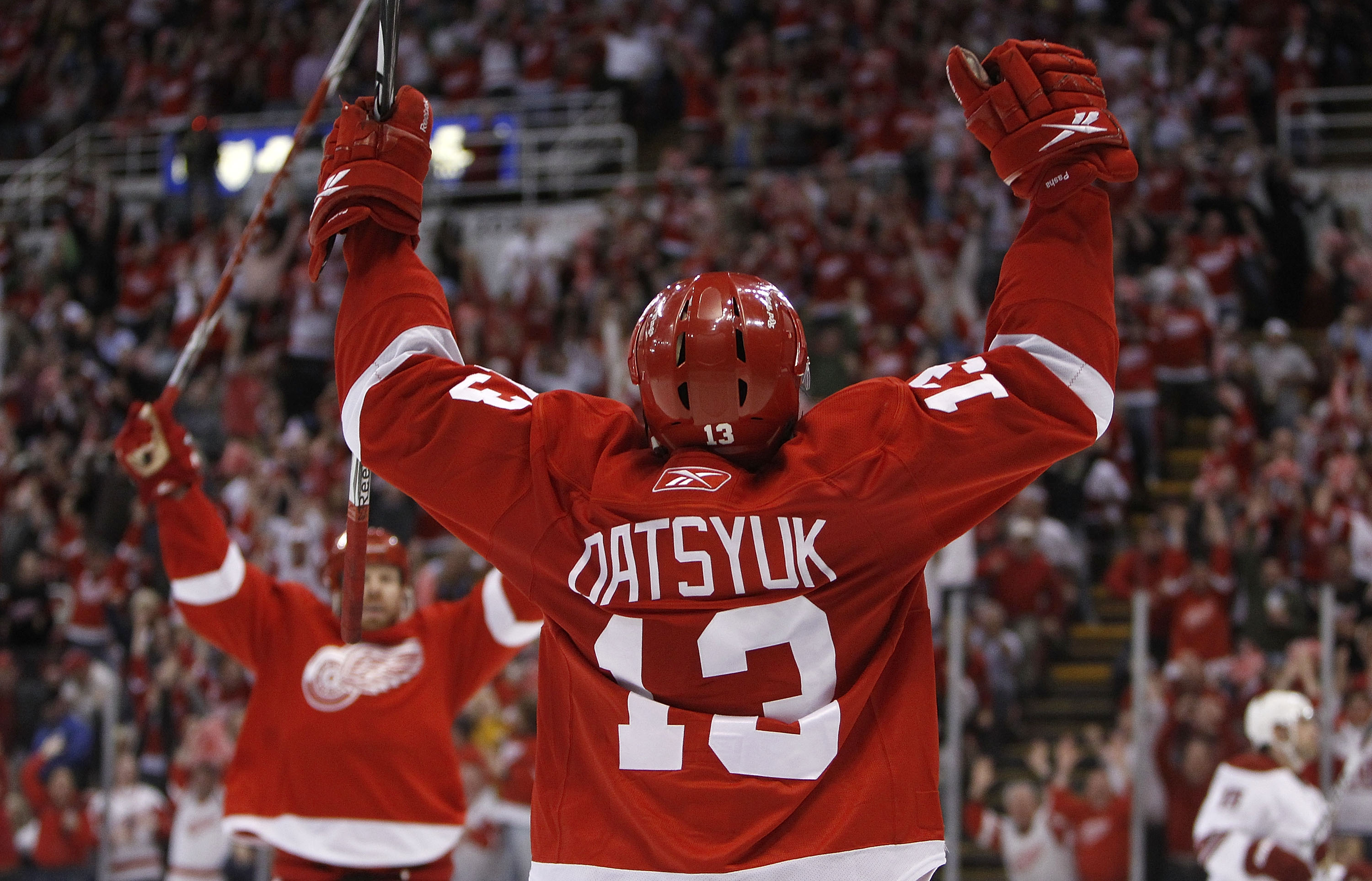 DETROIT - APRIL 20:  Pavel Datsyuk #13 of the Detroit Red Wings celebrates his third-period goal with Johan Franzen #93 while playing the Phoenix Coyotes in Game Four of the Western Conference Quarterfinals of the 2010 NHL Stanley Cup Playoffs on April 20