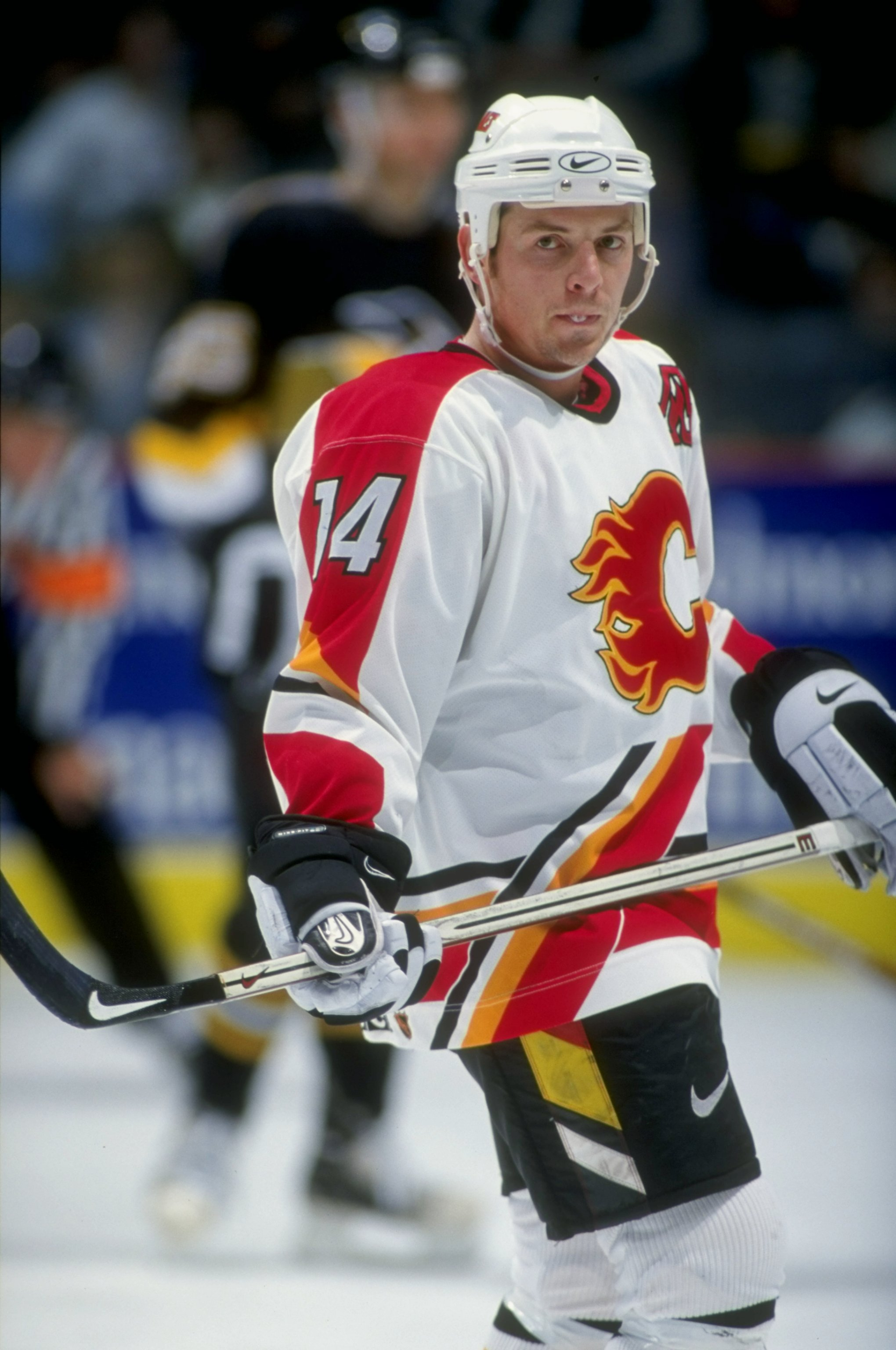 28 Oct 1998:   Rightwinger Theoren Fleury #14 of the Calgary Flames looks on during the game against the Pittsburgh Penguins at the Canadien Airlines Saddledome in Calgary, Alberta, Canada. The Penguins defeated the Flames 5-2. Mandatory Credit: Ian Tomli