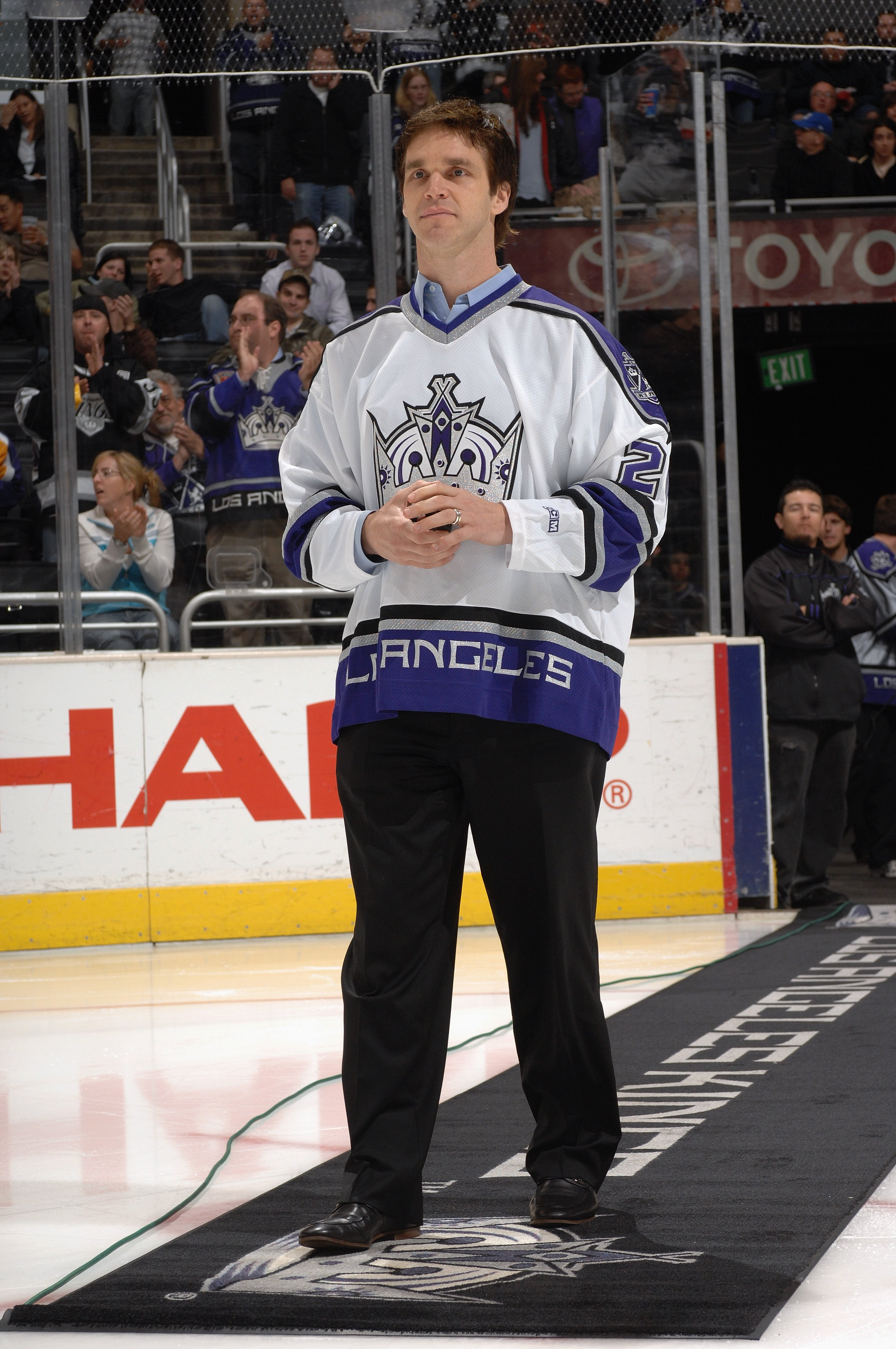 LOS ANGELES - MARCH 21:  Former Los Angeles Kings player Luc Robitaille walks out to center ice for the ceremonial face off before the game against the Dallas Stars on March 21, 2007 at Staples Center in Los Angeles, California. The Stars won 4-2. (Photo