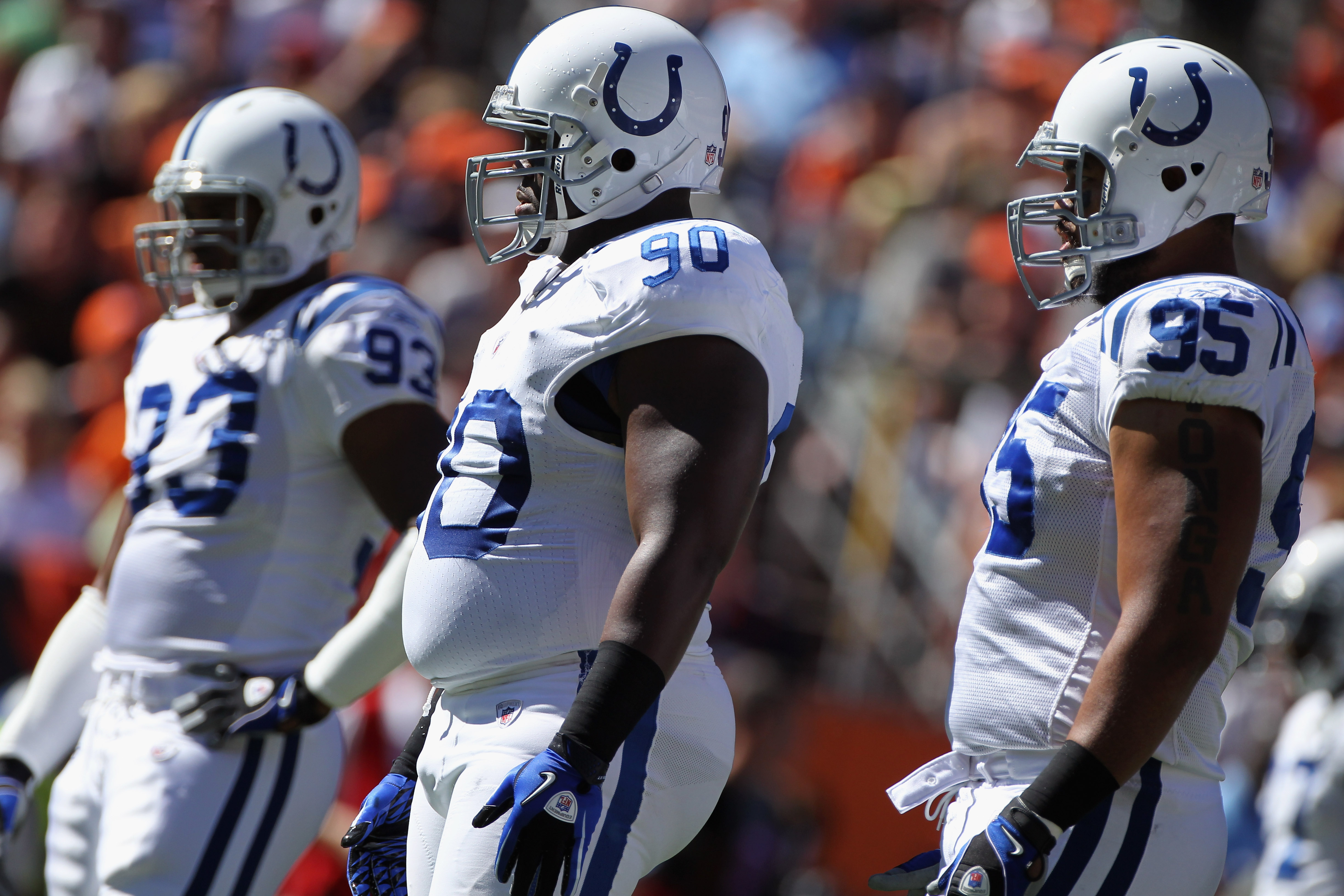 DENVER - SEPTEMBER 26:  Defensive linemen Dwight Freeney #93, Dan Muir #90 and Fili Moala #95 of the Indianapolis Colts prepare to play defense against the Denver Broncos at INVESCO Field at Mile High on September 26, 2010 in Denver, Colorado. The Colts d