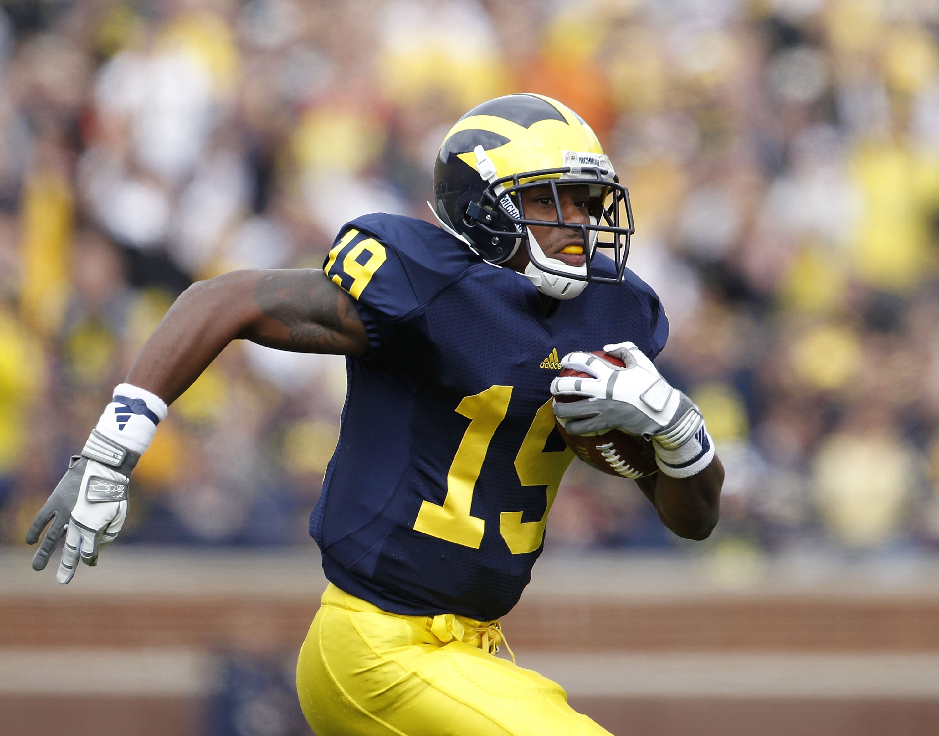 ANN ARBOR, MI - SEPTEMBER 25: Kelvin Grady #19 of the Michigan Wolverines runs for a 19 yard gain during the second quarter of the game against Bowling Green on September 25, 2010 at Michigan Stadium in Ann Arbor, Michigan. Michigan defeated Bowling Green