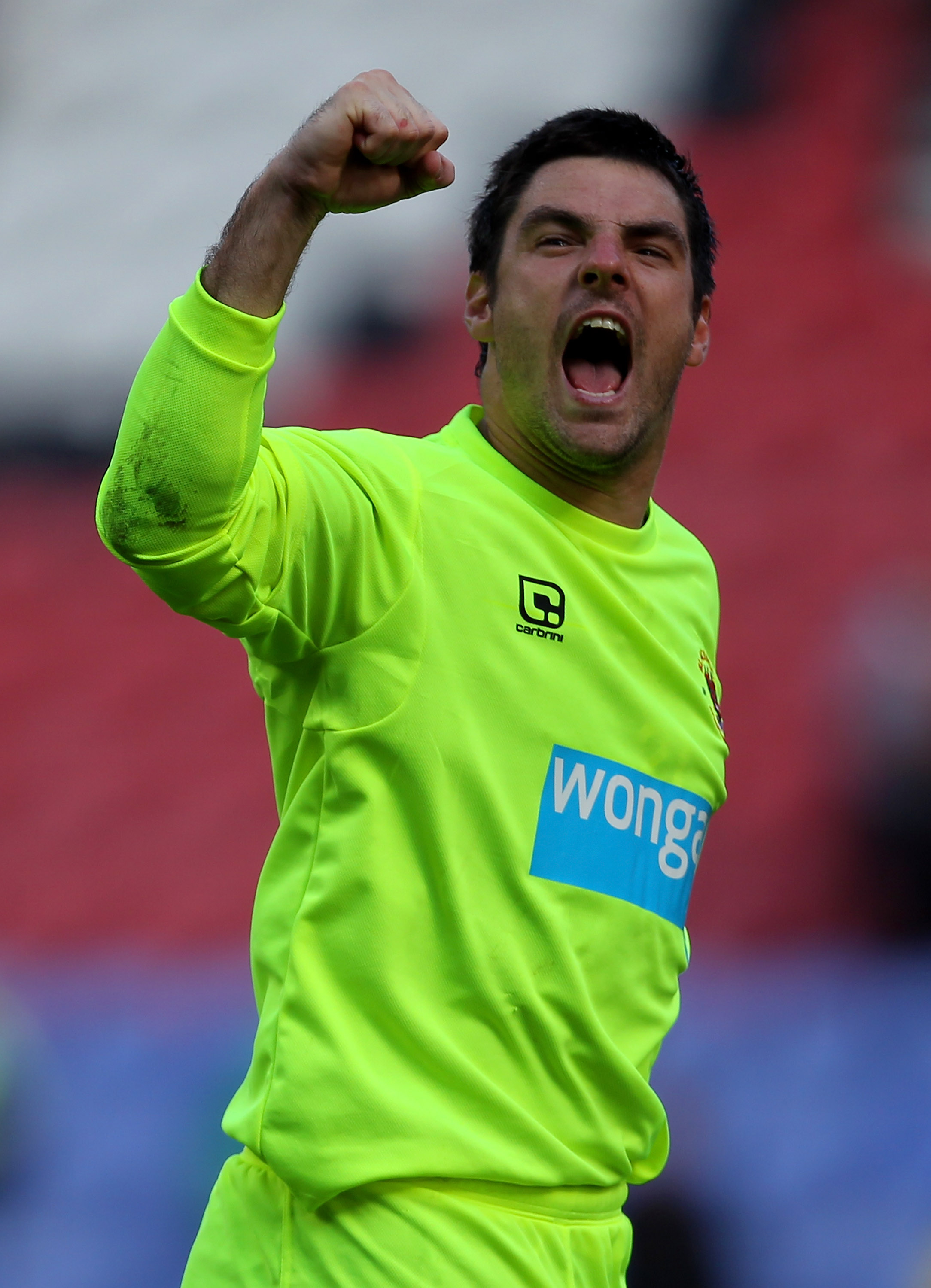 WIGAN, ENGLAND - AUGUST 14:  Matthew Gilks of Blackpool celebrates victory at the end of the Barclays Premier League match between Wigan Athletic and Blackpool at the DW Stadium on August 14, 2010 in Wigan, England.  (Photo by Alex Livesey/Getty Images)