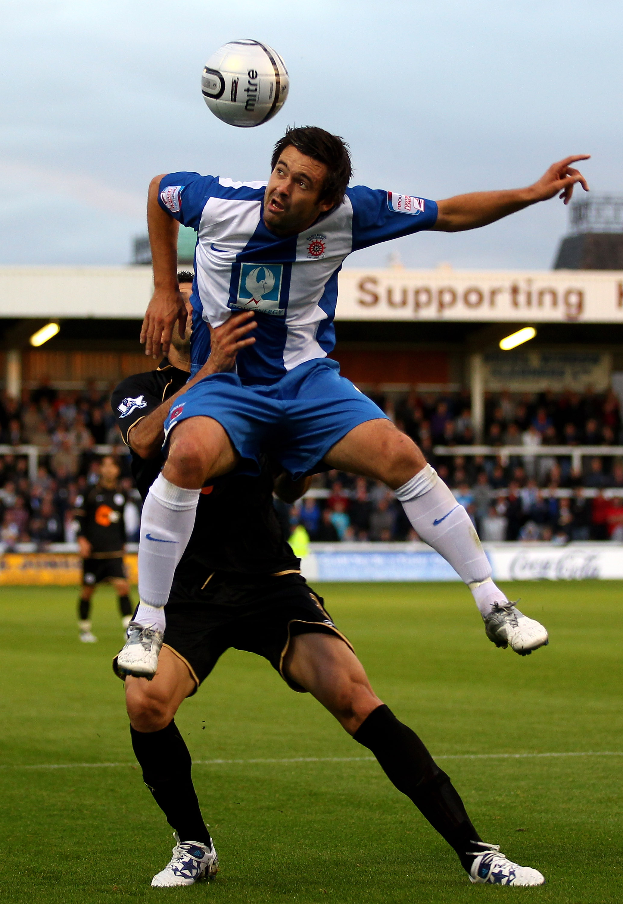 HARTLEPOOL, ENGLAND - AUGUST 24:  Adam Boyd of Hartlepool United rises above Antolin Alcaraz of Wigan Athletic during the Carling Cup second round match between Hartlepool United and Wigan Athletic at Victoria Park on August 24, 2010 in Hartlepool, Englan