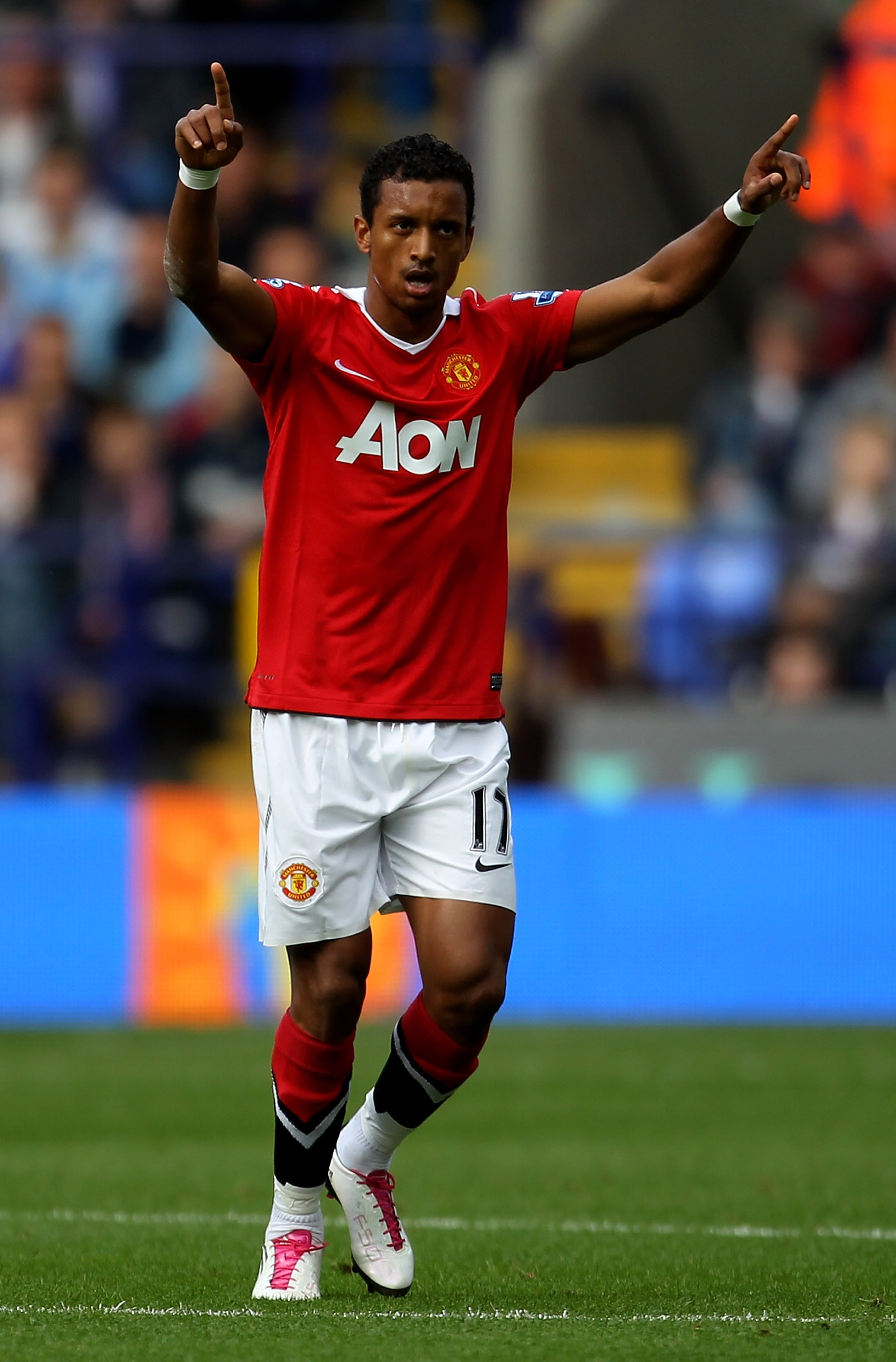BOLTON, ENGLAND - SEPTEMBER 26:   Nani of Manchester United celebrates scoring his team's first goal during the Barclays Premier League match between Bolton Wanderers and Manchester United at the Reebok Stadium on September 26, 2010 in Bolton, England. (P