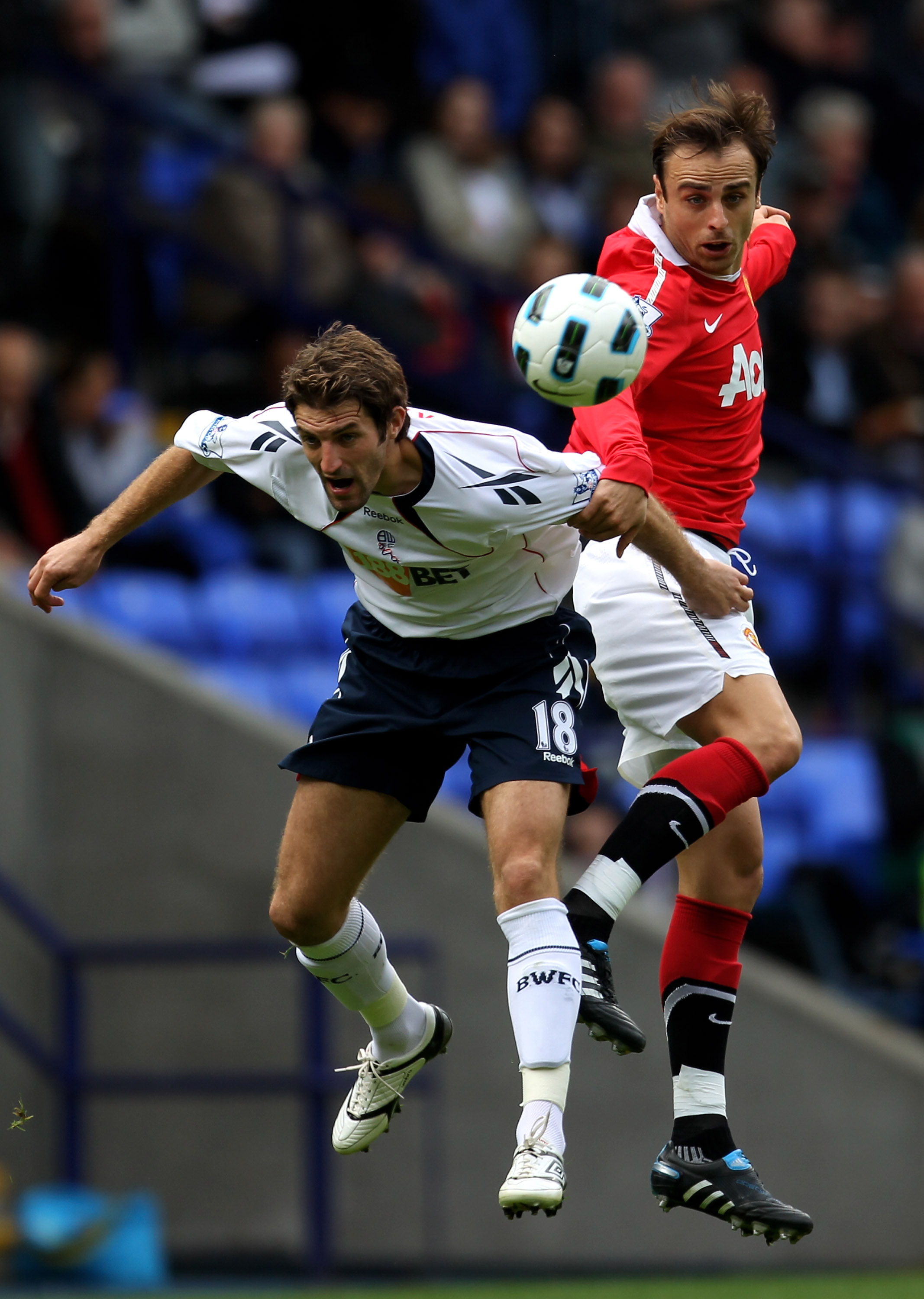 BOLTON, ENGLAND - SEPTEMBER 26:  Sam Ricketts of Bolton Wanderers competes with Dimitar Berbatov of Manchester United during the Barclays Premier League match between Bolton Wanderers and Manchester United at the Reebok Stadium on September 26, 2010 in Bo