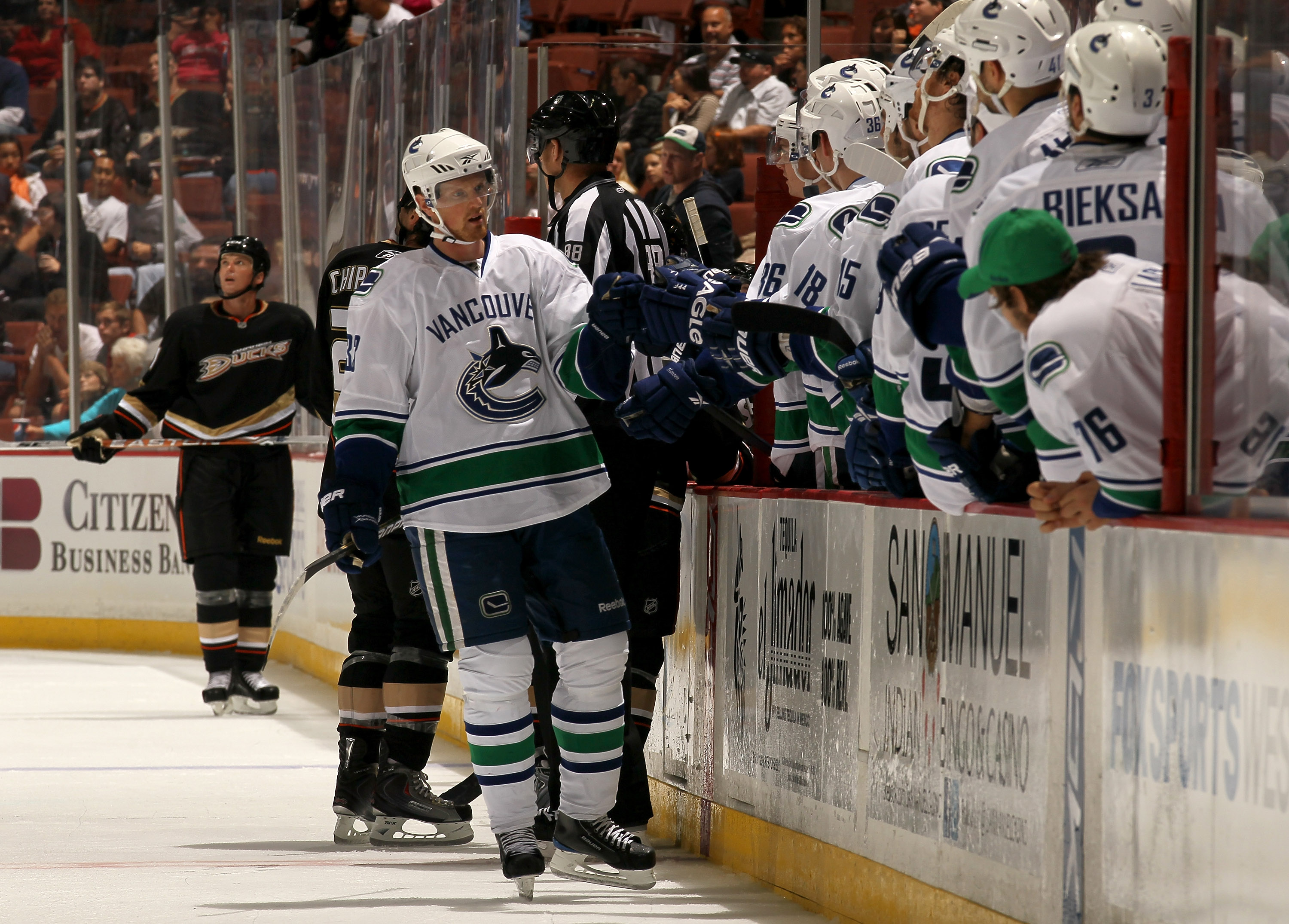 ANAHEIM, CA - OCTOBER 1:  Henrik Sedin #33 of the Vancouver Canucks  skates by the bench after scoring the go ahead goal in the third period against the Anaheim Ducks at Honda Center on October 1, 2010 in Anaheim, California.  Vancouver won 4-2.  (Photo b