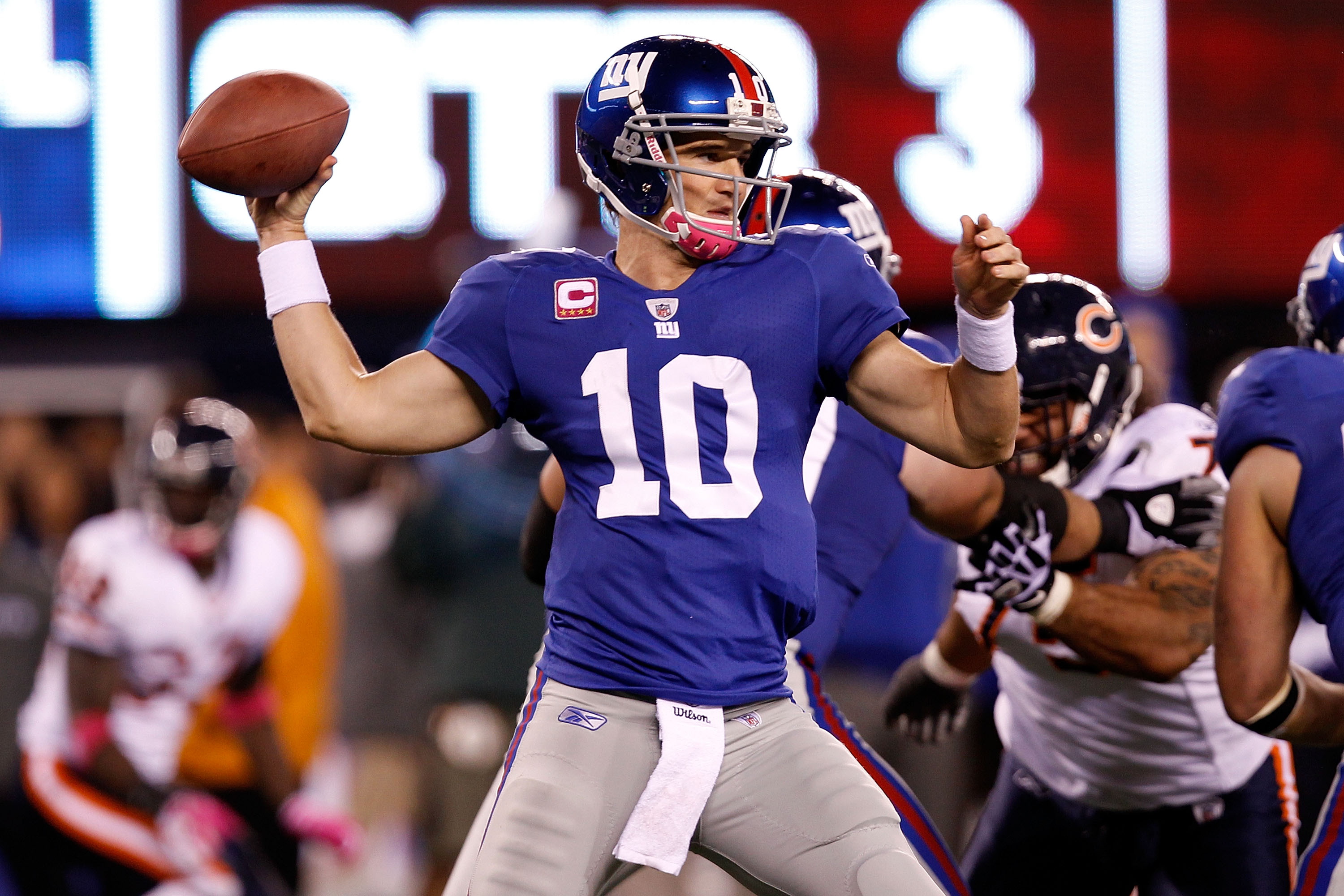 EAST RUTHERFORD, NJ - OCTOBER 03:  Eli Manning #10 of the New York Giants drops back against the Chicago Bears at New Meadowlands Stadium on October 3, 2010 in East Rutherford, New Jersey.  (Photo by Michael Heiman/Getty Images)