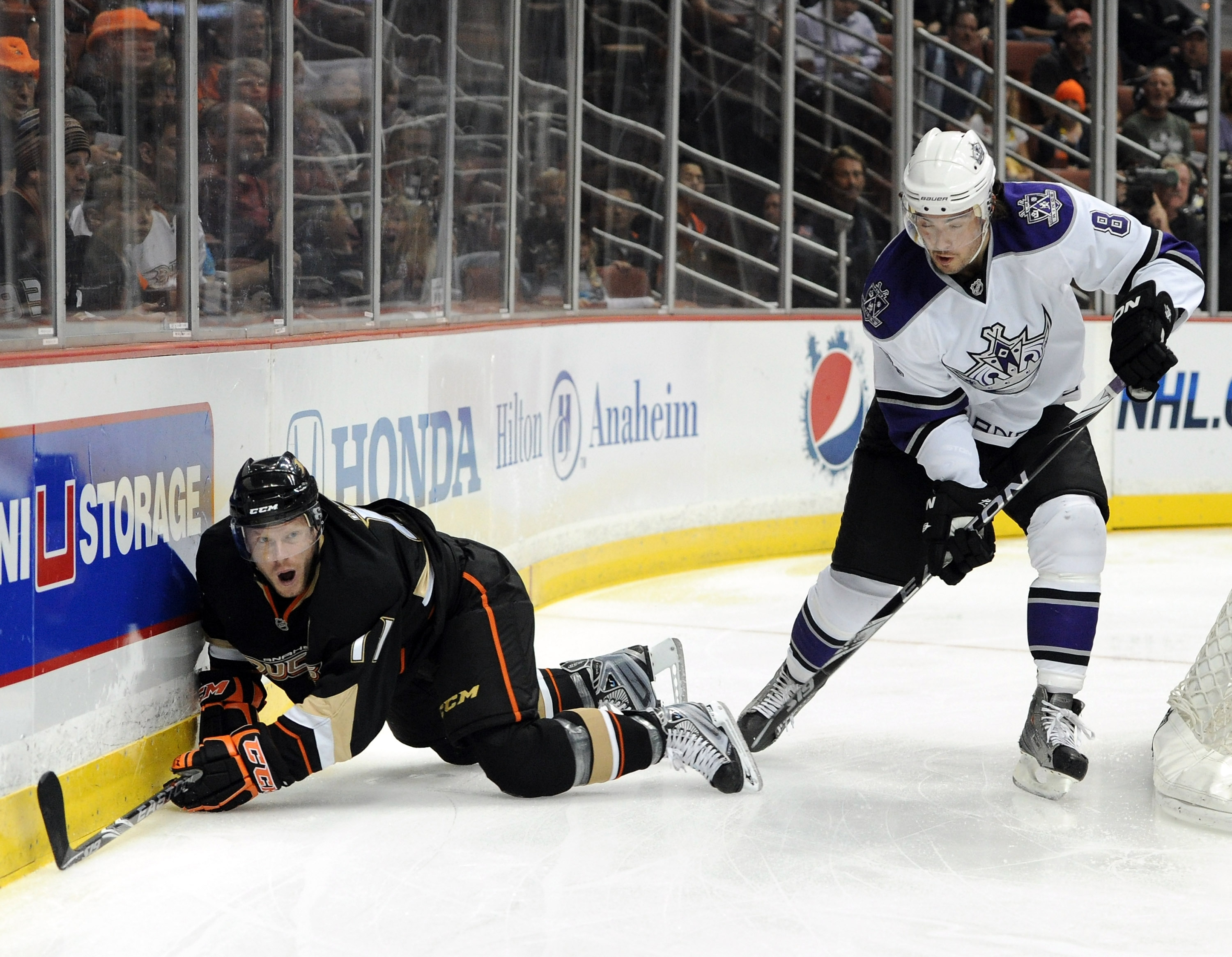 ANAHEIM, CA - OCTOBER 03:  Drew Doughty #8 of the Los Angeles Kings takes a penalty as he knocks Jason Blake #33 of the Anaheim Ducks to the ice during the first period at Honda Center on October 3, 2010 in Anaheim, California.  (Photo by Harry How/Getty