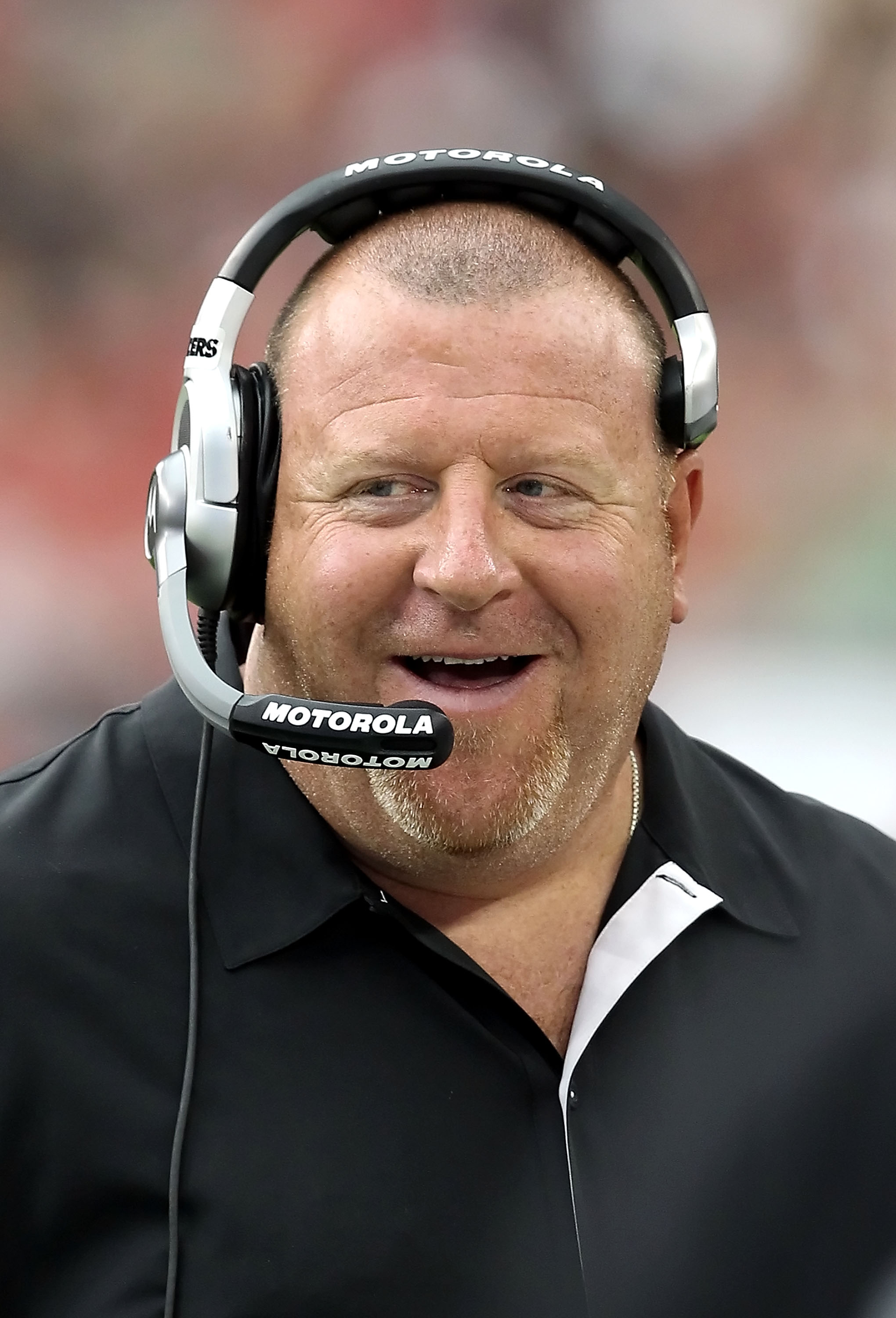 GLENDALE, AZ - SEPTEMBER 26:  Head coach Tom Cable of the Oakland Raiders smiles on the sidelines during the NFL game against the Arizona Cardinals at the University of Phoenix Stadium on September 26, 2010 in Glendale, Arizona.  The Cardinals defeated th