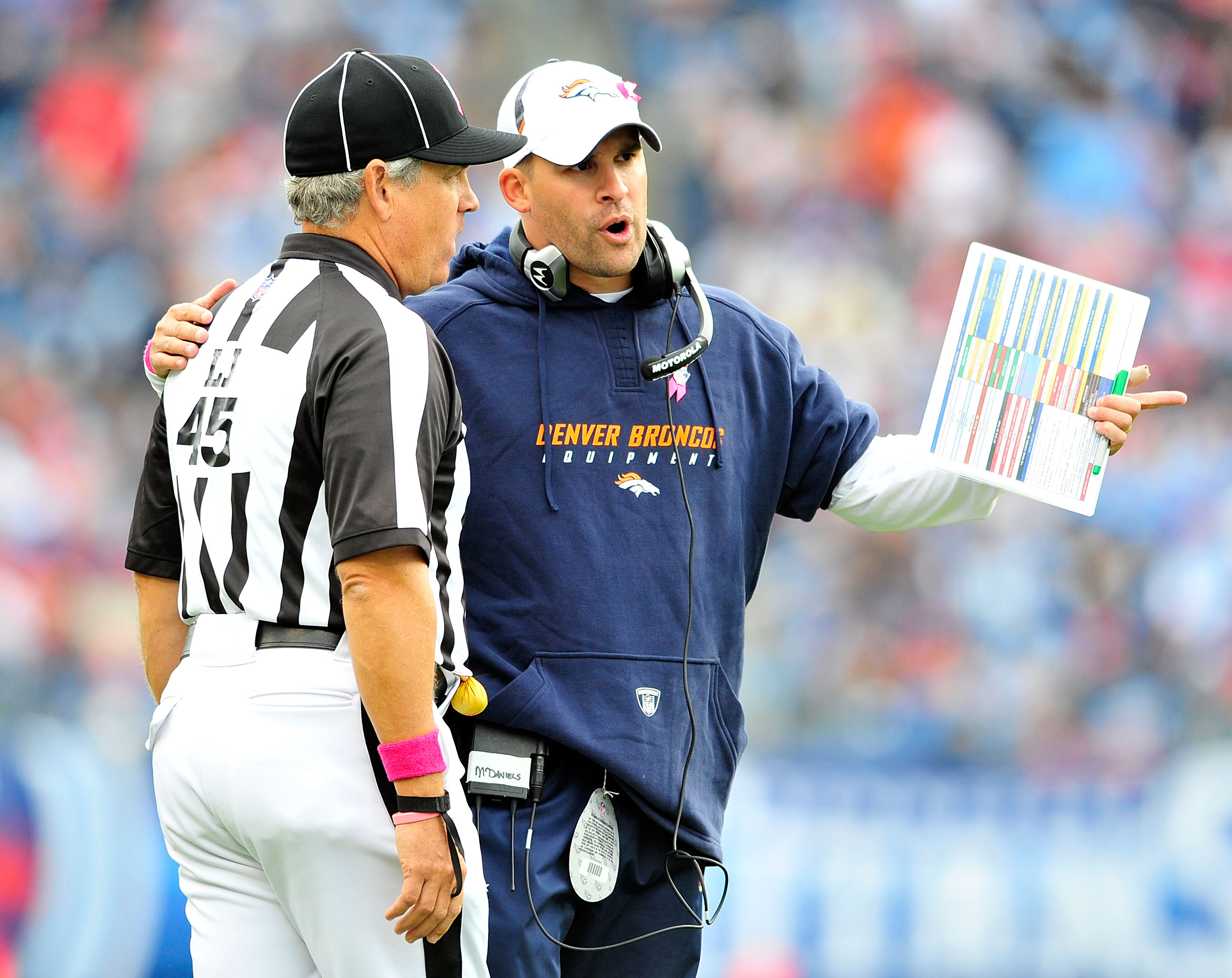 NASHVILLE, TN - OCTOBER 03:  Coach Josh McDaniels of the Denver Broncos confers with an official during a game against the Tennessee Titans  at LP Field on October 3, 2010 in Nashville, Tennessee. Denver won 26-20.  (Photo by Grant Halverson/Getty Images)
