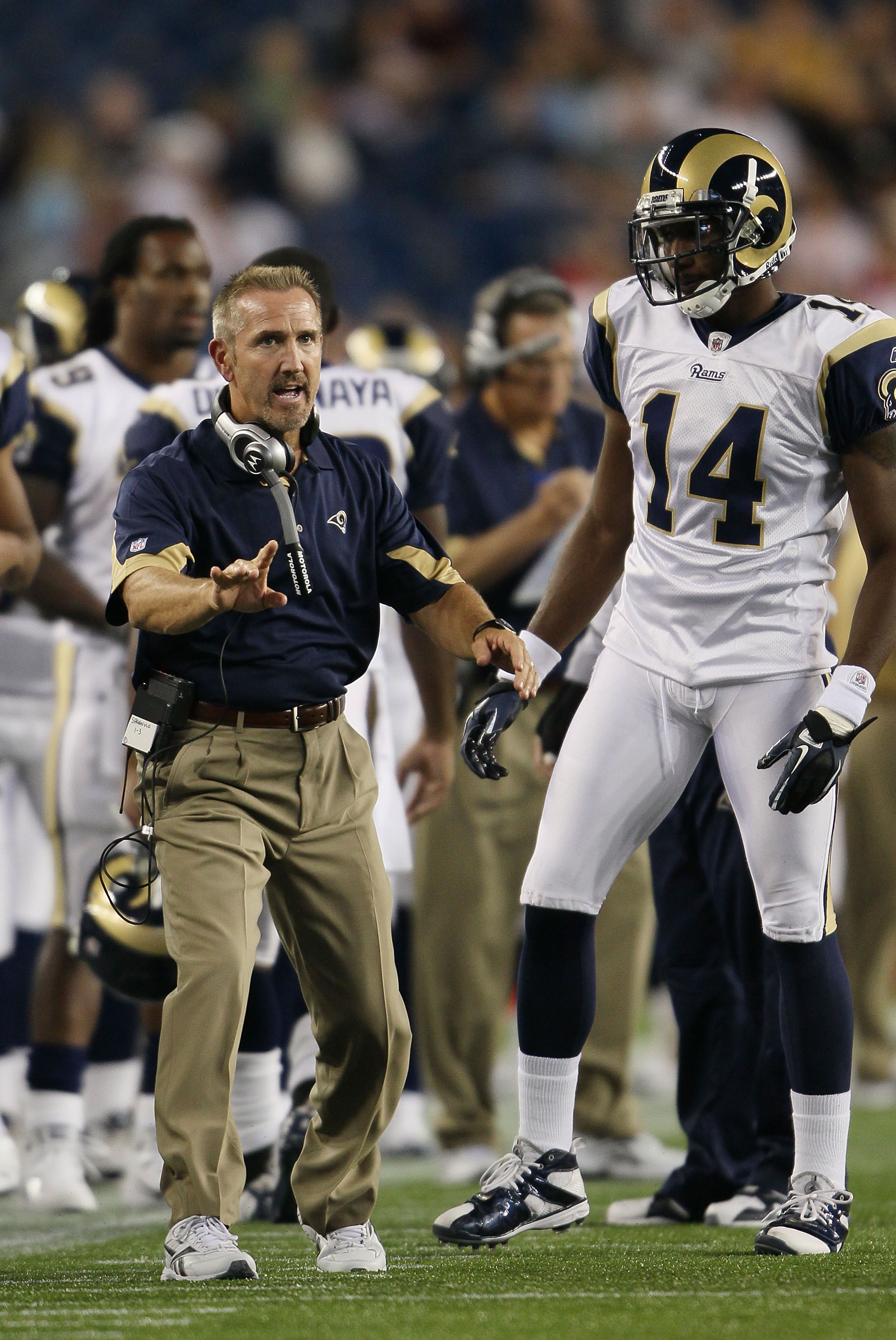 FOXBORO, MA - AUGUST 26:  Head coach Steve Spagnuolo of the St. Louis Rams talks with Keenan Burton #14 in the second half against the New England Patriots on August 26, 2010 at Gillette Stadium in Foxboro, Massachusetts. The Rams defeated the Patriots 36