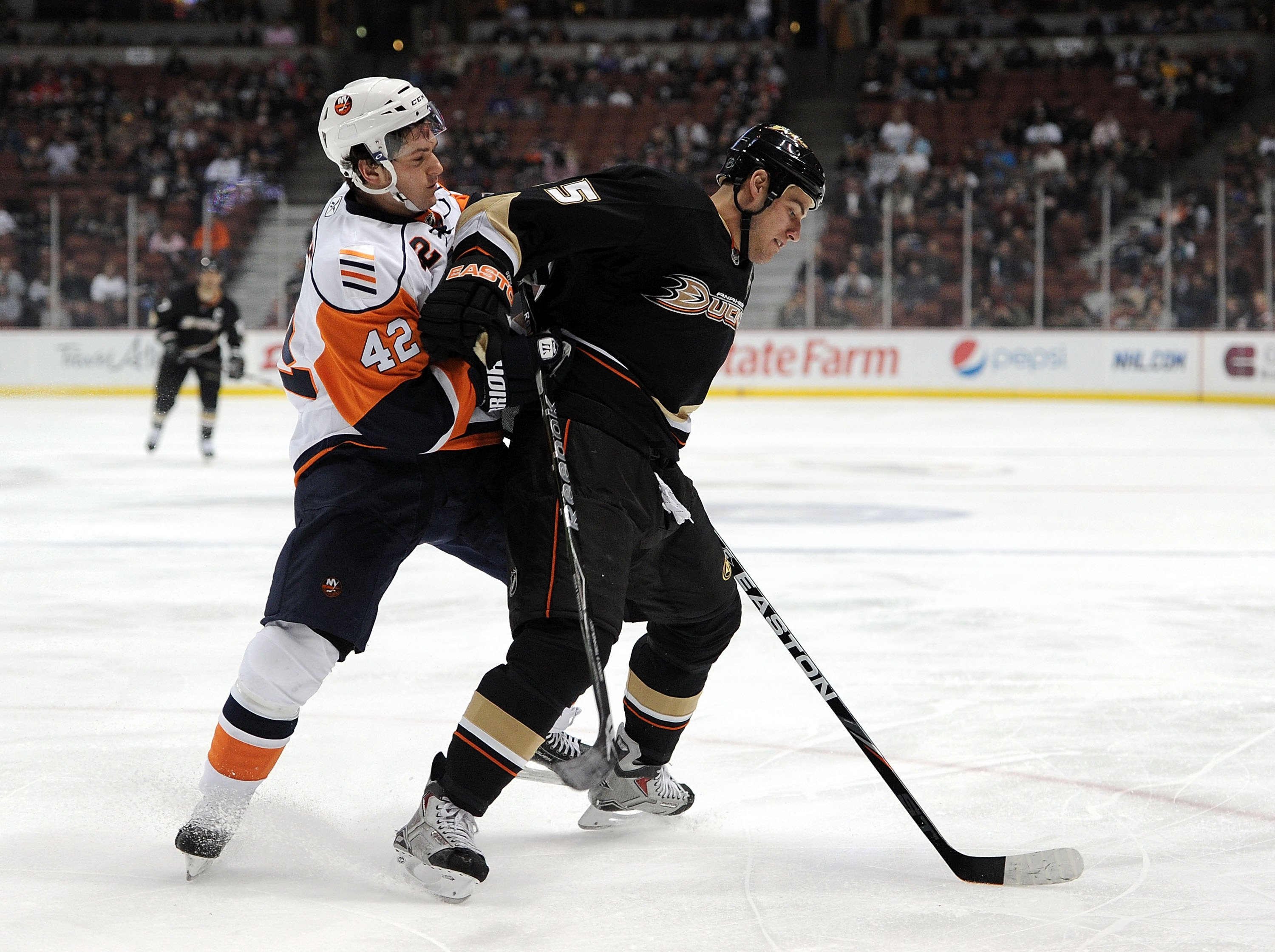 ANAHEIM, CA - MARCH 19:  Ryan Getzlaf #15 of the Anaheim Ducks fends off Dylan Reese #42 of the New York Islanders at the Honda Center on March 19, 2010 in Anaheim, California.  (Photo by Harry How/Getty Images)