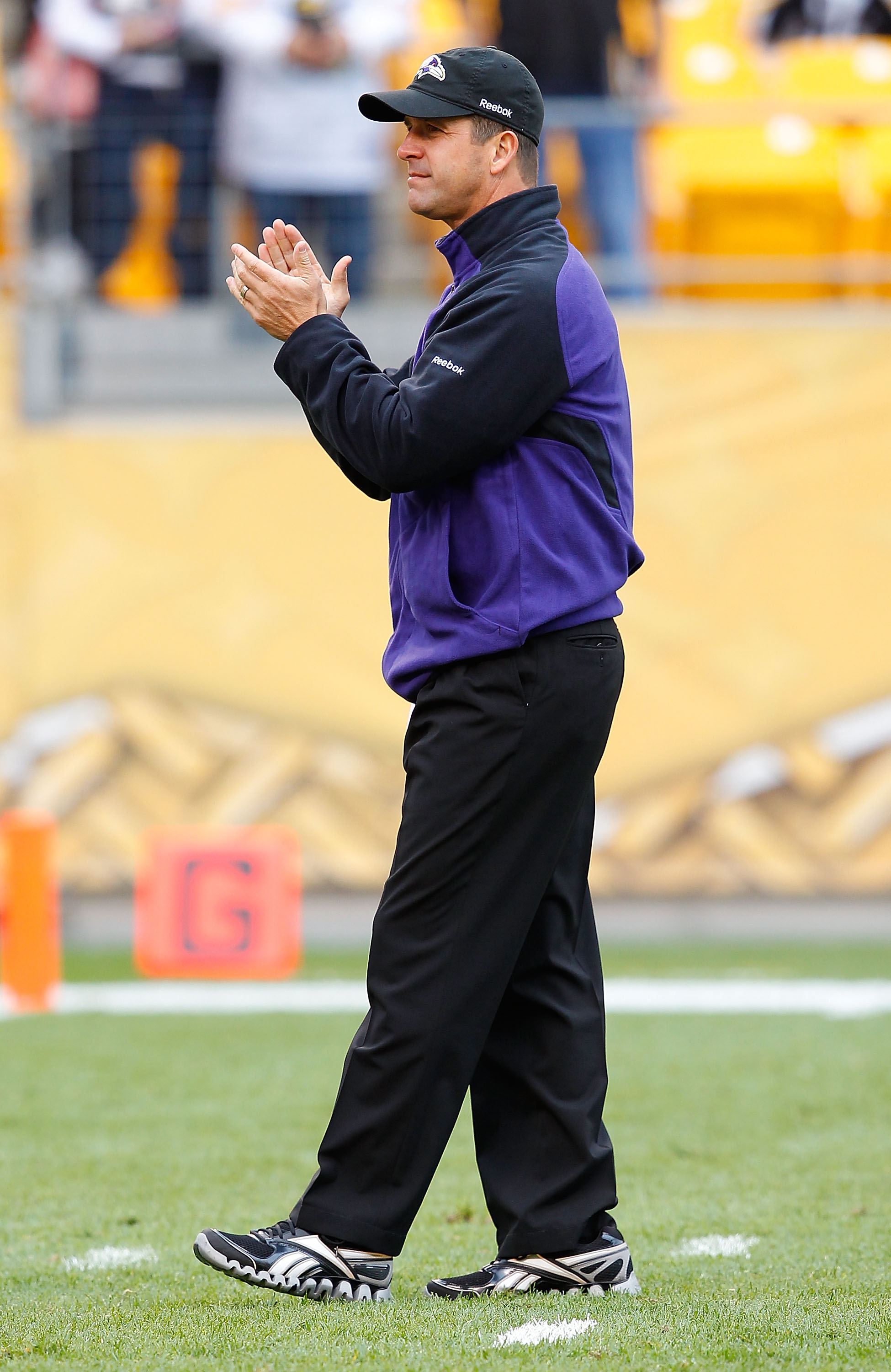 PITTSBURGH - OCTOBER 03:  Head coach John Harbaugh of the Baltimore Ravens watches his team practice prior to the game against the Pittsburgh Steelers on October 3, 2010 at Heinz Field in Pittsburgh, Pennsylvania.  (Photo by Jared Wickerham/Getty Images)