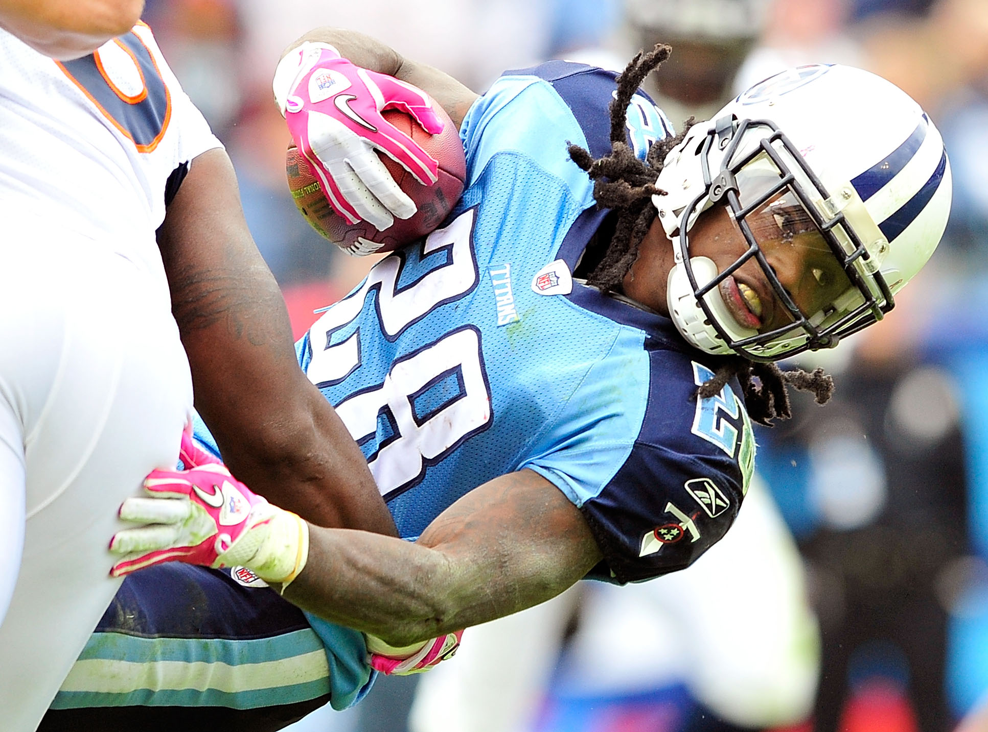 NASHVILLE, TN - OCTOBER 03:  Chris Johnson #28 of the Tennessee Titans stretches for extra yards against the Denver Broncos at LP Field on October 3, 2010 in Nashville, Tennessee. Denver won 26-20.  (Photo by Grant Halverson/Getty Images)