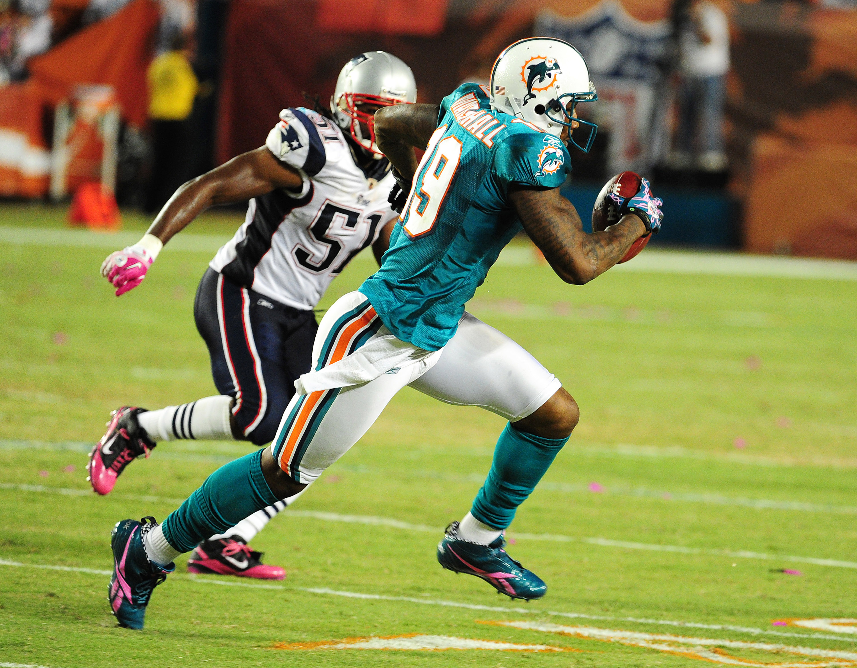 MIAMI - OCTOBER 4: Brandon Marshall #19 of the Miami Dolphins runs with a catch against the New England Patriots at Sun Life Field on October 4, 2010 in Miami, Florida. (Photo by Scott Cunningham/Getty Images)
