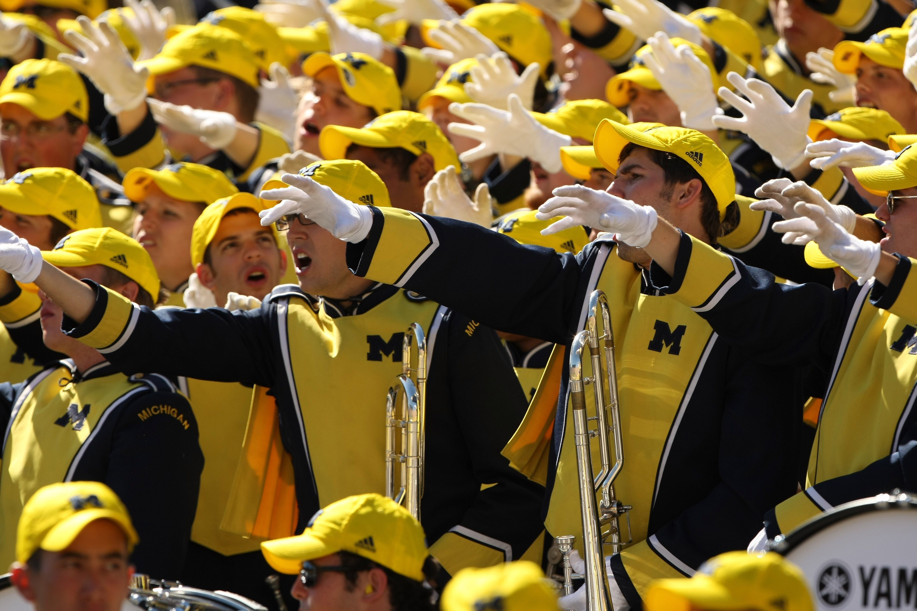 ANN ARBOR, MI - SEPTEMBER 19:  Members of the Michigan Wolverines band cheer in the game against the Eastern Michigan Eagles at Michigan Stadium on September 19, 2009 in Ann Arbor, Michigan. Michigan won 45-17.  (Photo by Stephen Dunn/Getty Images)