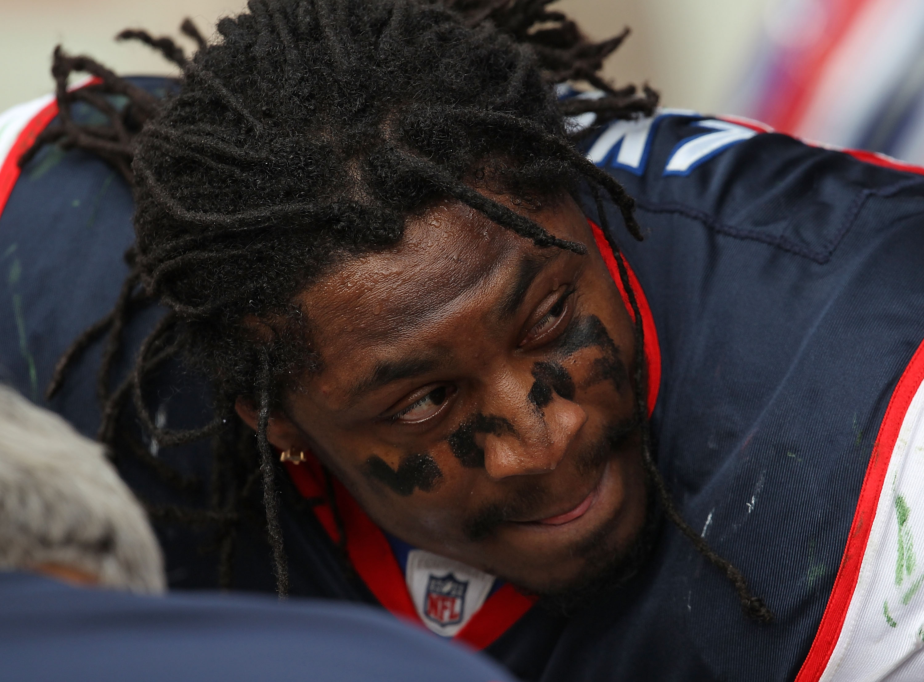 GREEN BAY, WI - SEPTEMBER 19: Marshawn Lynch #23 of the Buffalo Bills listens to coaches and teammates on the sidelines during a game against the Green Bay Packers at Lambeau Field on September 19, 2010 in Green Bay, Wisconsin. The Packers defeated the Bi