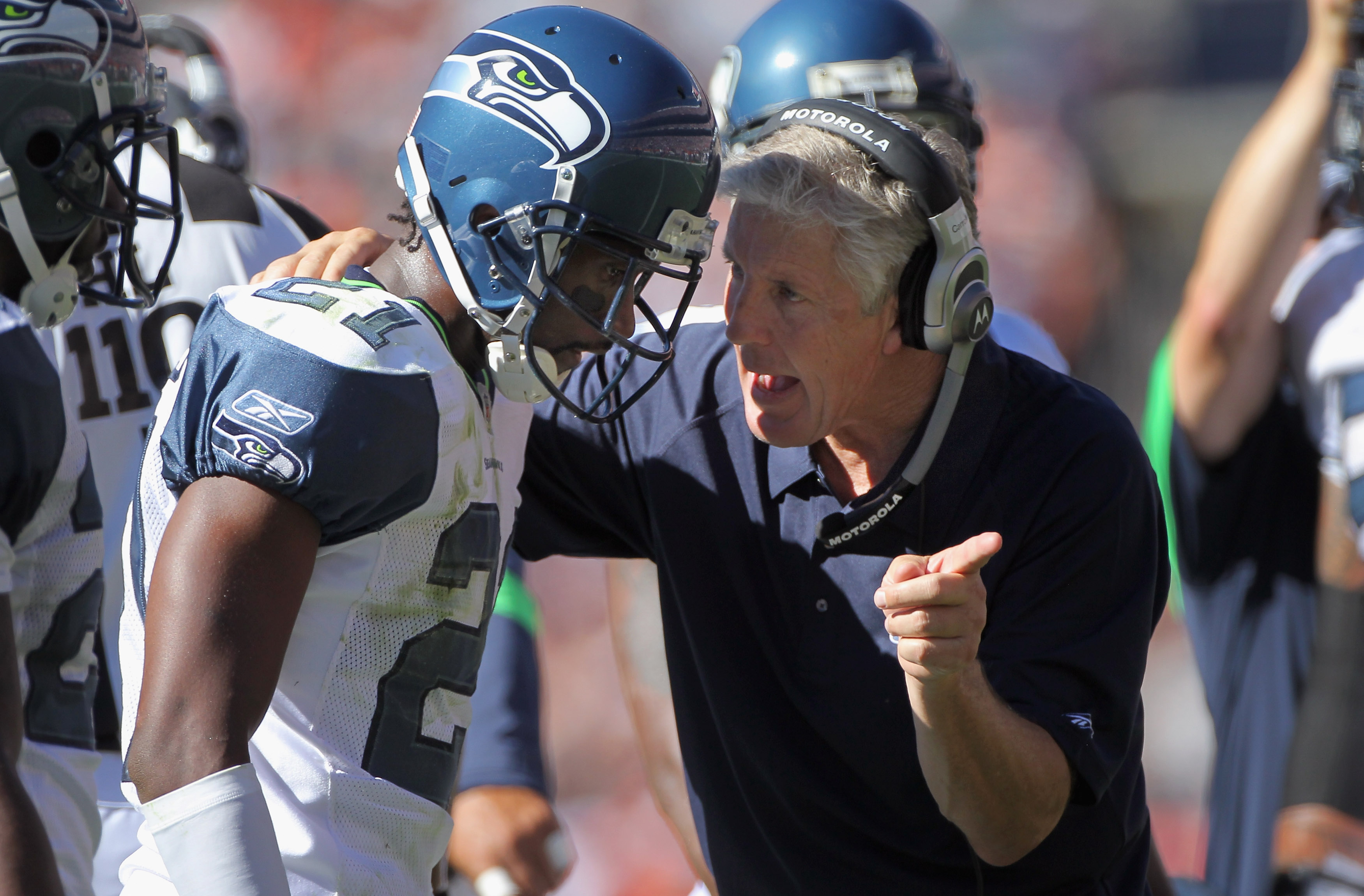 DENVER - SEPTEMBER 19:  Head coach Pete Carroll of the Seattle Seahawks directs cornerback Kelly Jennings #21 during a break in the action against the Denver Broncos at INVESCO Field at Mile High on September 19, 2010 in Denver, Colorado. The Broncos defe