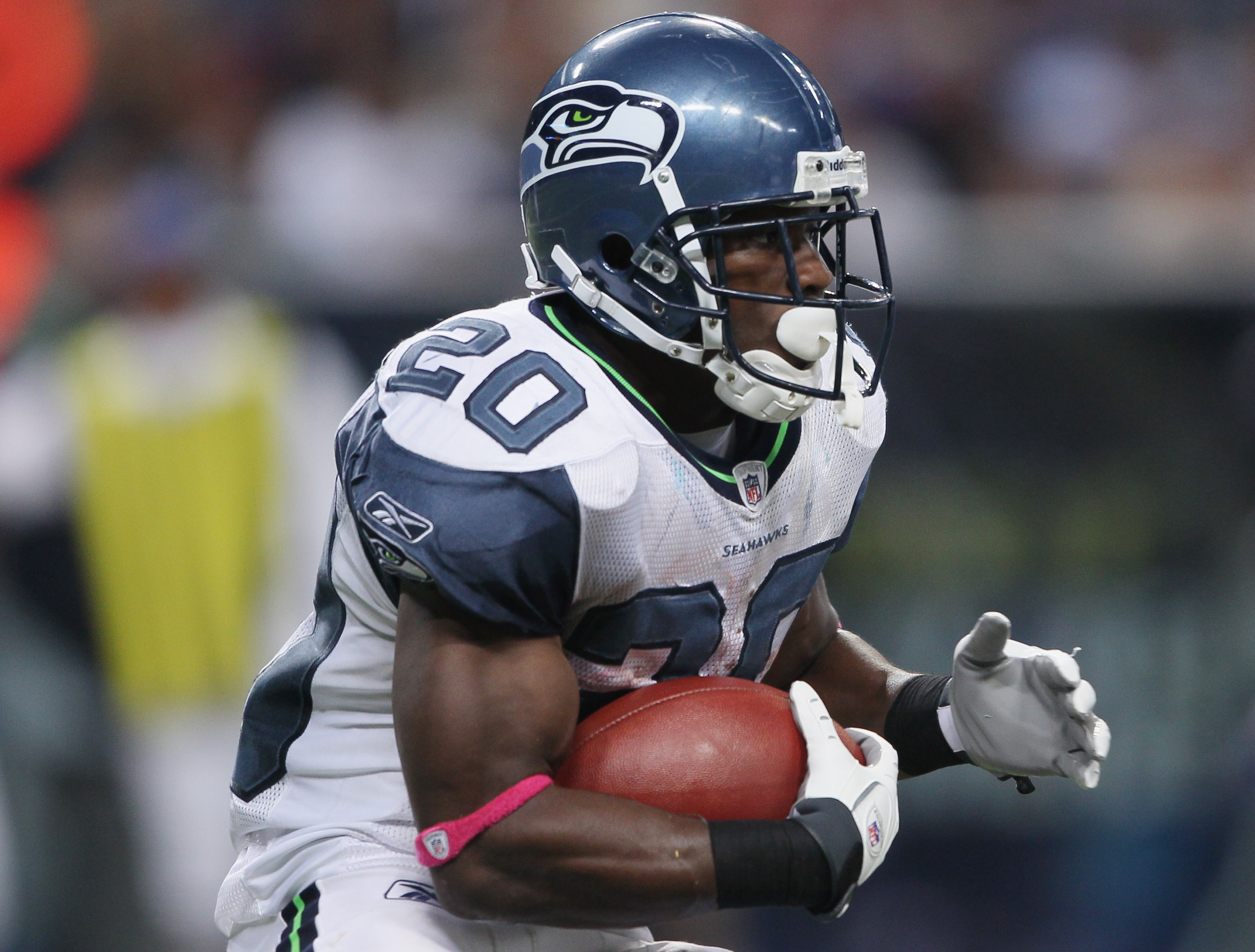 ST. LOUIS - OCTOBER 03:  :  Justin Forsett #20 of the Seattle Seahawks carries the ball in the first half against the St. Louis Rams on October 3, 2010 at Edward Jones Dome in St. Louis, Missouri.  (Photo by Elsa/Getty Images)