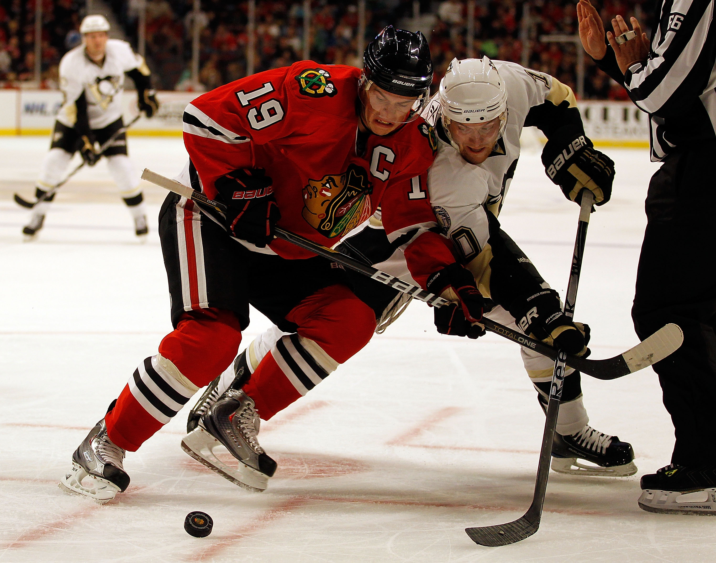 CHICAGO - OCTOBER 01: Jonathan Toews #19 of the Chicago Blackhawks and Mark Letestu #10 of the Pittsburgh Penguins battle for the puck after a face-off during a pre-season game at the United Center on October 1, 2010 in Chicago, Illinois. The Blackhawks d