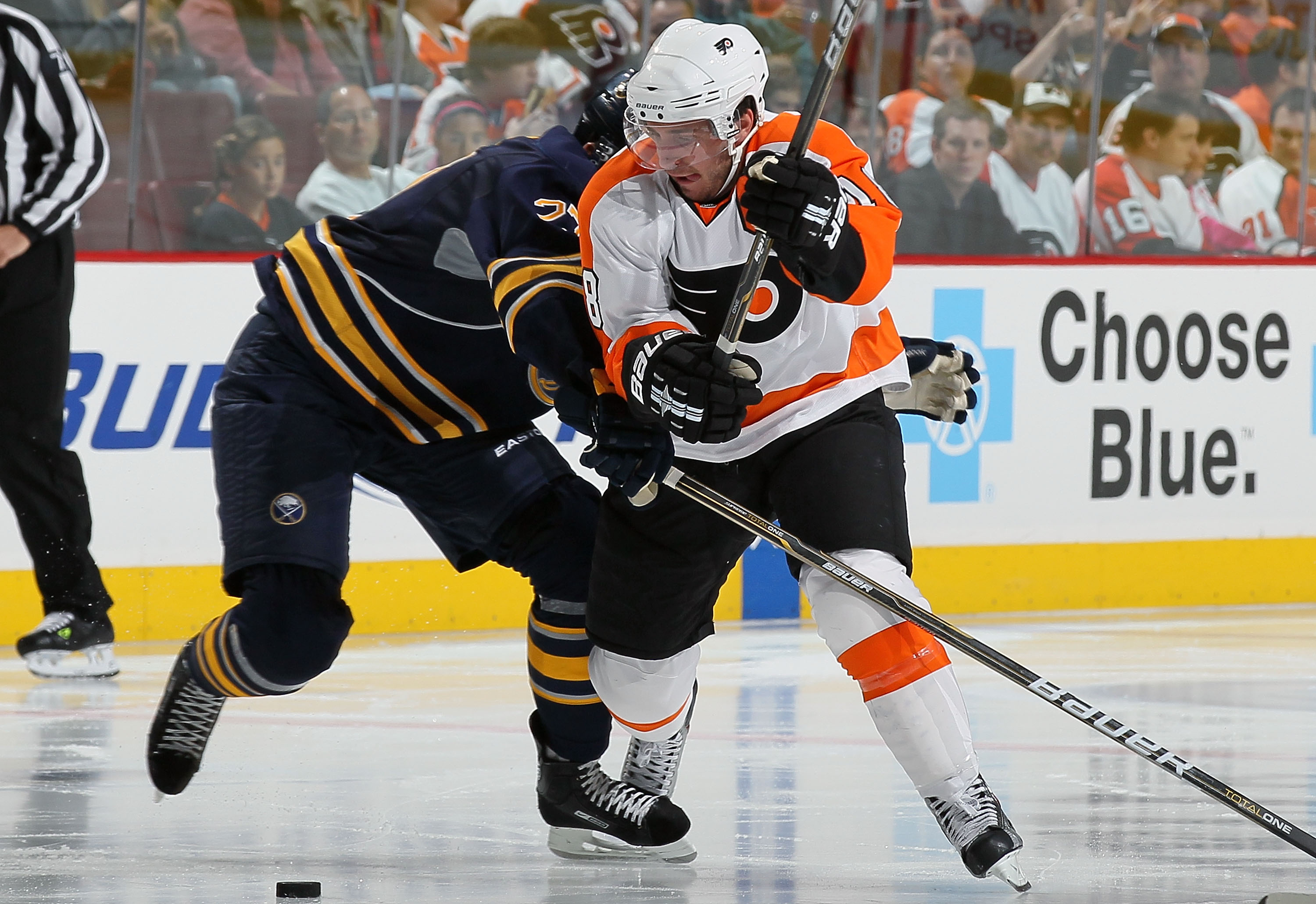 PHILADELPHIA - OCTOBER 01:  Mike Richards #18 of the Philadelphia Flyers makes a move against Shaone Morrisonn #27 of the Buffalo Sabres on October 1, 2010 at Wells Fargo Center in Philadelphia, Pennsylvania.  (Photo by Jim McIsaac/Getty Images)