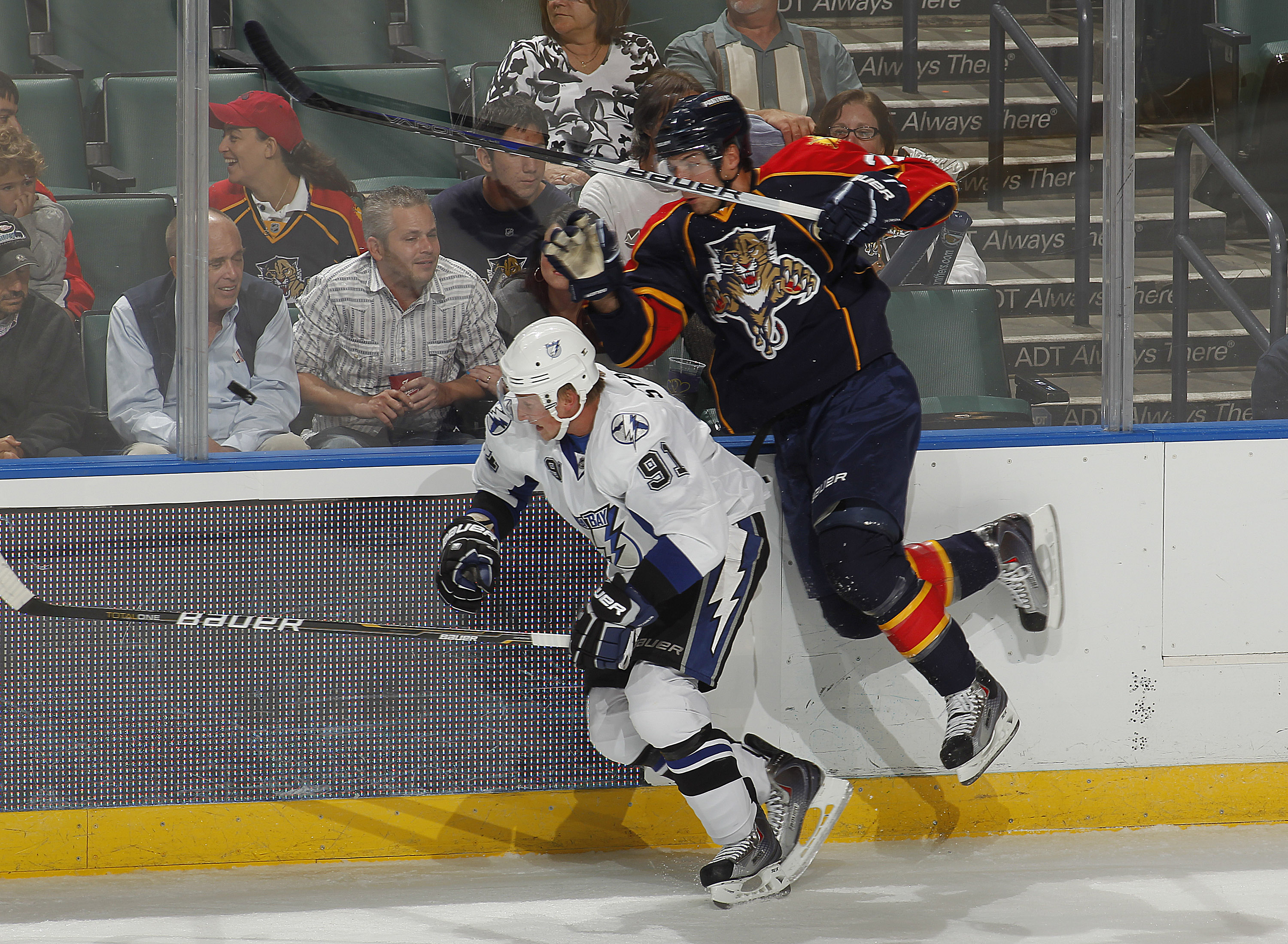 SUNRISE, FL - OCTOBER 1: Steve Bernier #26 of the Florida Panthers attempts to pass Steven Stamkos #91 of the Tampa Bay Lightning while chasing the puck during a pre season game on October 1, 2010 at the BankAtlantic Center in Sunrise, Florida. The Lightn