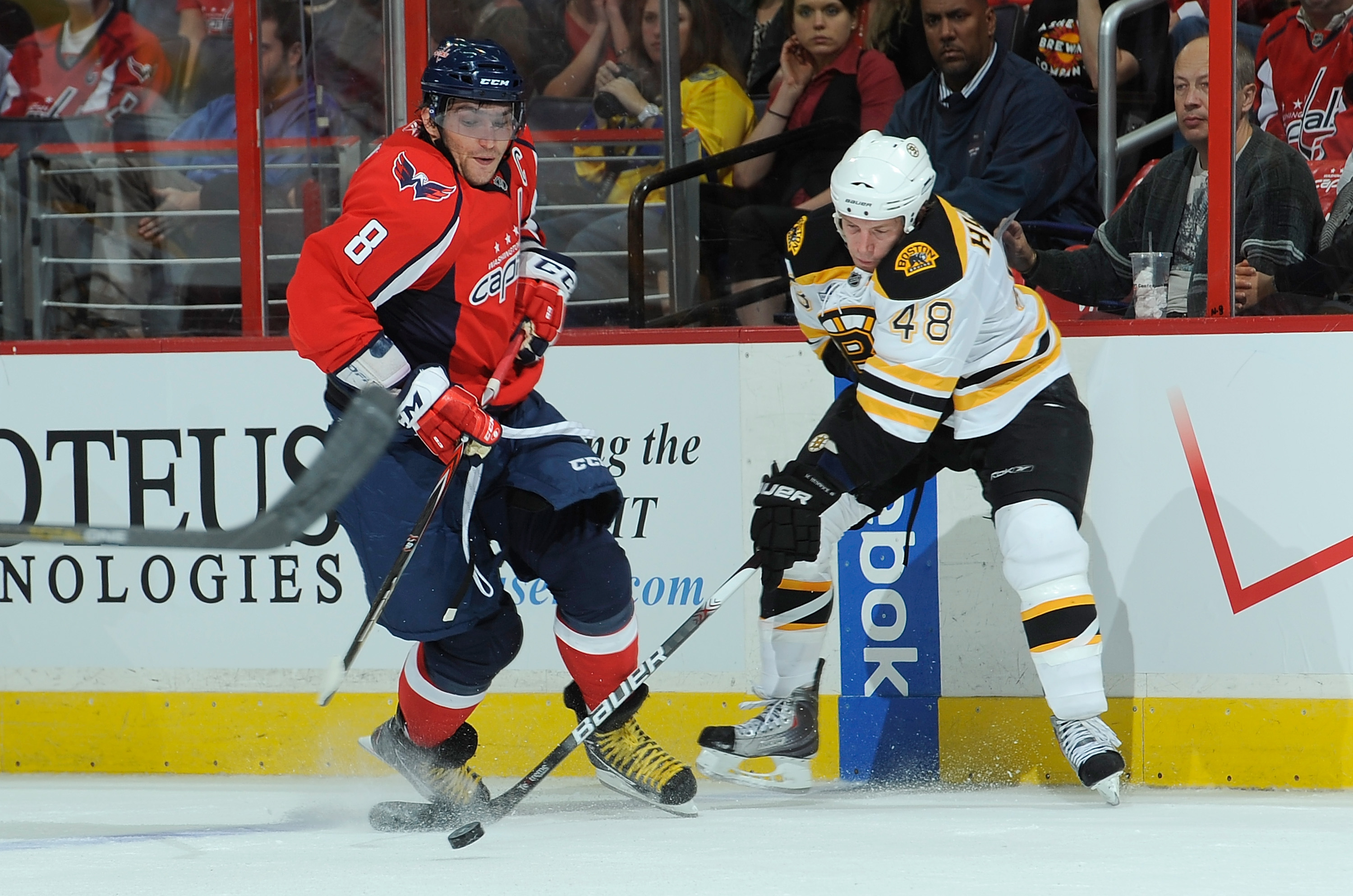 WASHINGTON - SEPTEMBER 28:  Alex Ovechkin #8 of the Washington Capitals battles for the puck with Matt Hunwick #48 of the Boston Bruins at Verizon Center on September 28, 2010 in Washington, DC.  (Photo by Greg Fiume/Getty Images)